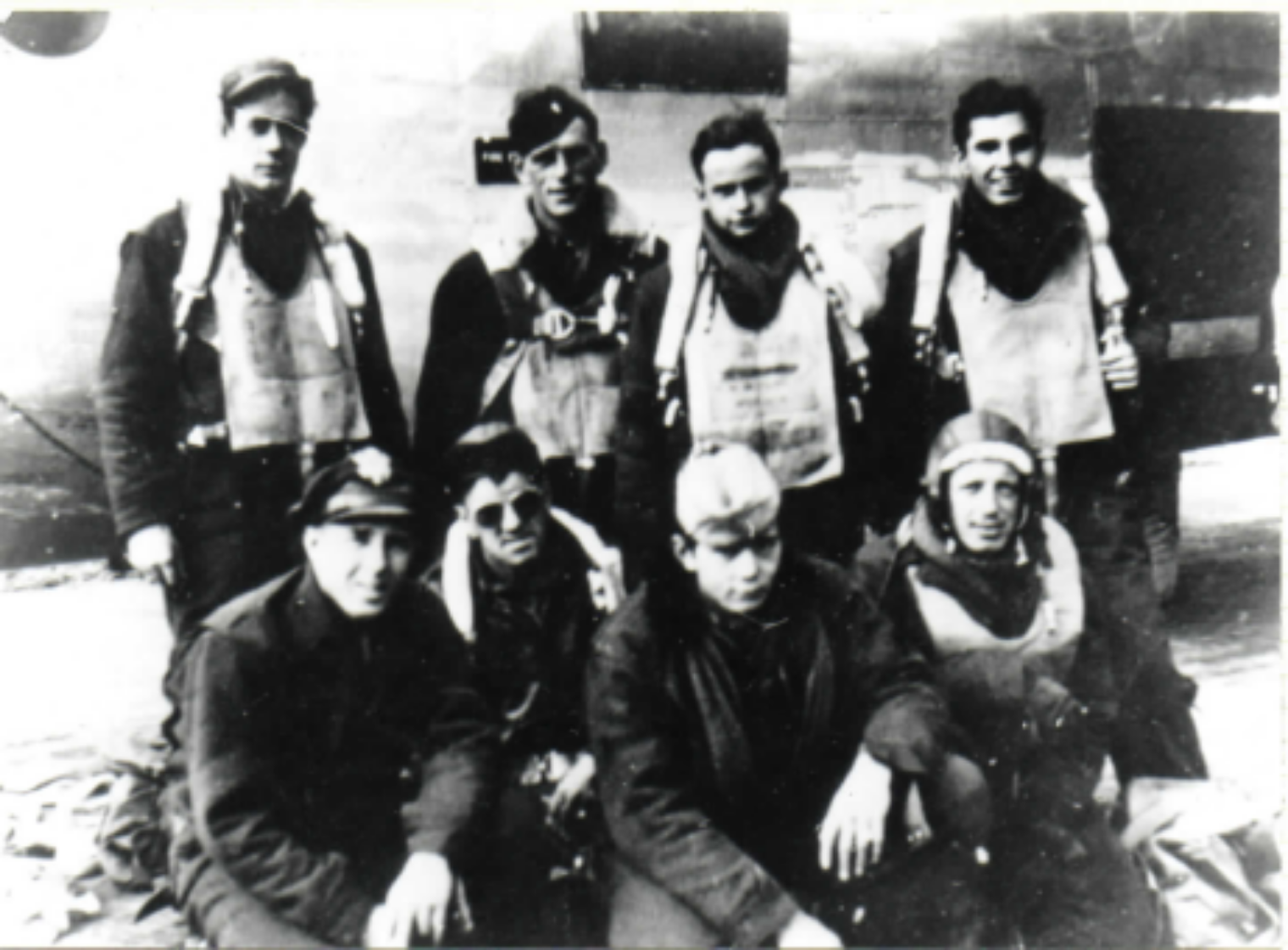 Back row, L to R: S/Sgt. Stephen Gray, Eng. POW; 2nd Lt. Palmer M. Bruland, Pilot, POW; Unknown; Unknown, POW. Front row: 2nd Lt. Norman J. Cuddy, Nav., POW,believed to be on left. Others on crew but not pictured include S/Sgt. Lee Huffman, waist gunner,and S/Sgt. Ferdinand Flach, nose gunner, both of whom were murdered after they parachuted down safely and were captured; T/Sgt. James H. Boman, radio operator, POW; S/Sgt. Hugh J. Sullivan, waist gunner, POW; S/Sgt.Charles M. Dove, tail gunner, POW. Also not pictured is copilot Peter Belitsos.