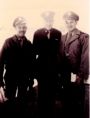 Left to right:  John A. Friese, bombardier; Maynard L. Jones, navigator; Carroll G. Snidow, copilot