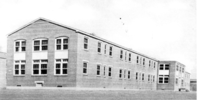 Partial view of one of the ward buildings of Schick General Hospital, Clinton, Iowa. The Hospital was named after 1st Lt. William Rineheart Schick, MC, (1940-1941) and operated from 12 Feb 43 until 25 Feb 46
