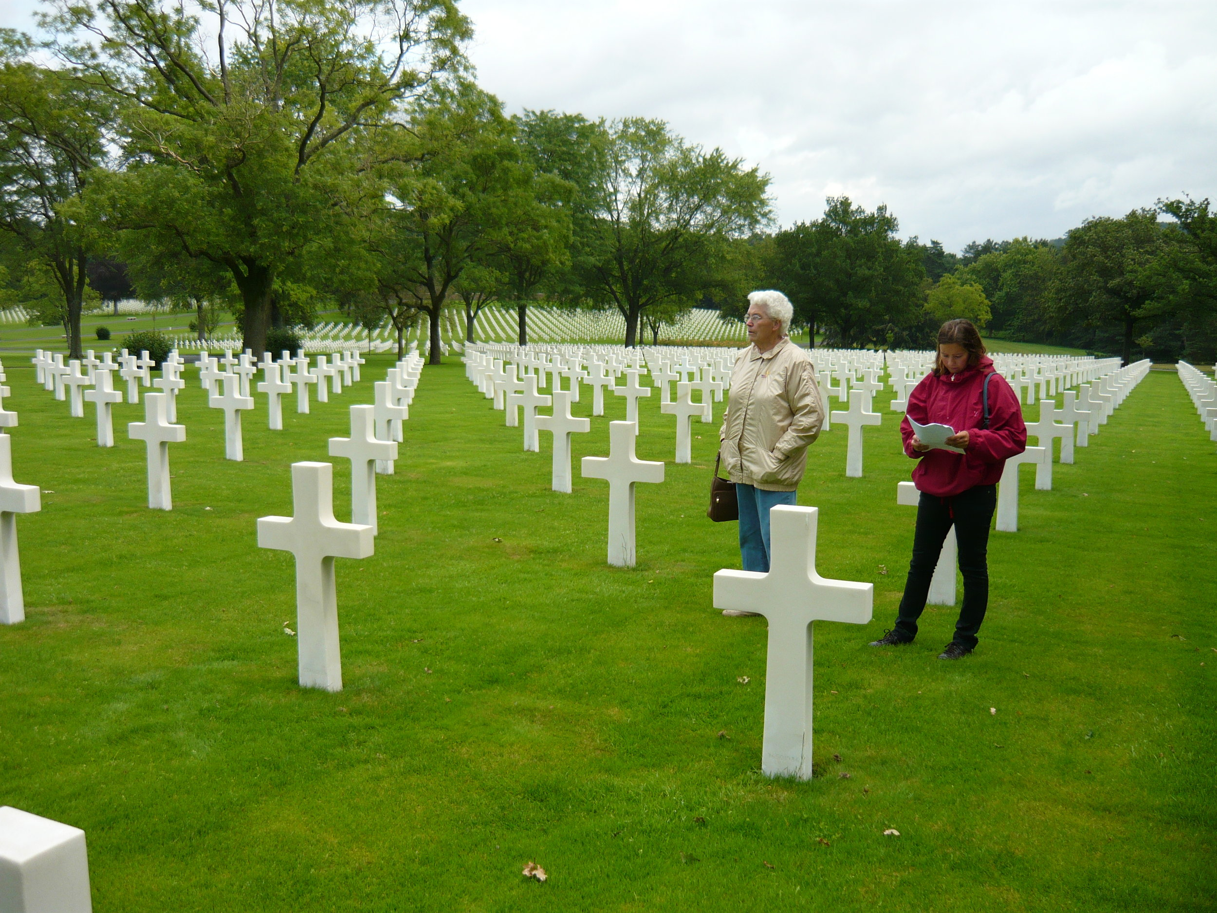 Erlyn at her brother's grave. Sophie Haelbig, Eb's daughter, accompanies her in this photo.