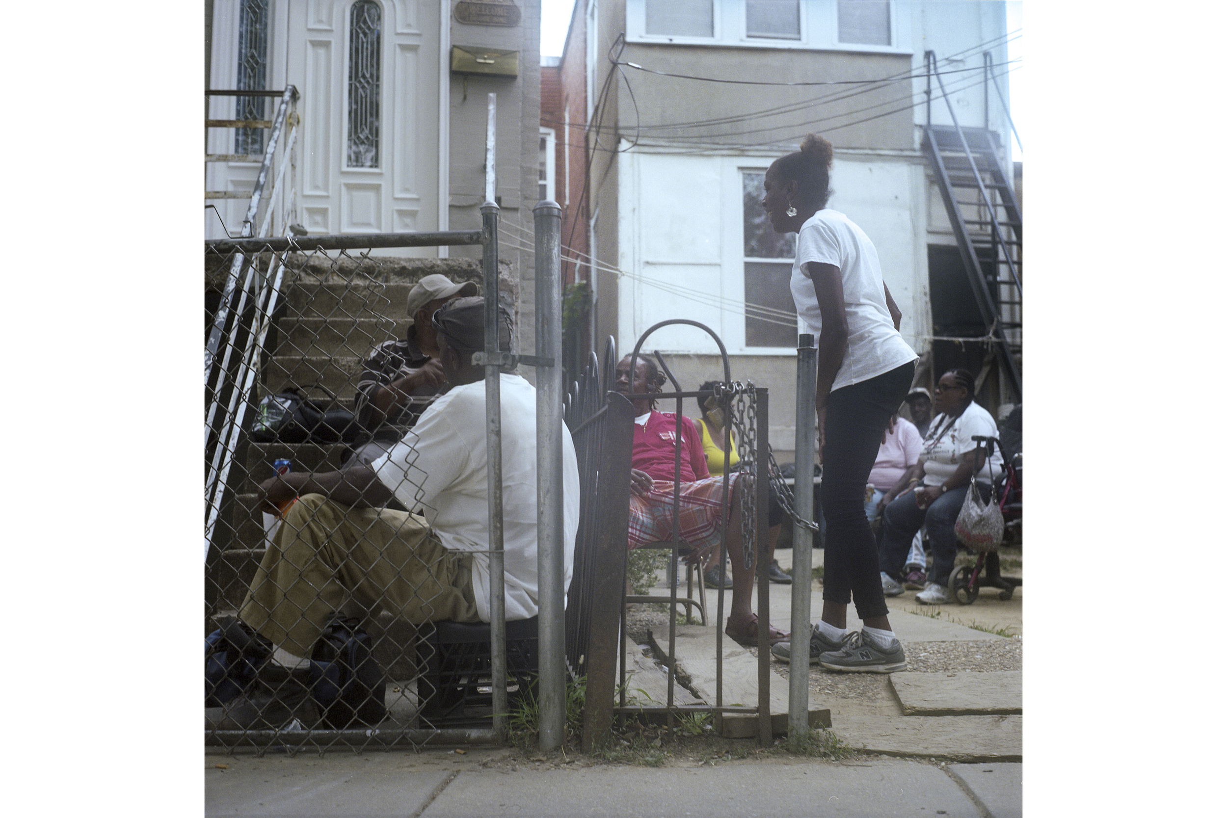 """Veronica (center, white shirt) raised six children in the Northeast area of Washington D.C. """"I have an """"S"""" on my chest,"""" she says. But as developers move in, she isn't sure how long she will be able to afford to stay in this neighborhood where she has lived all her life."""