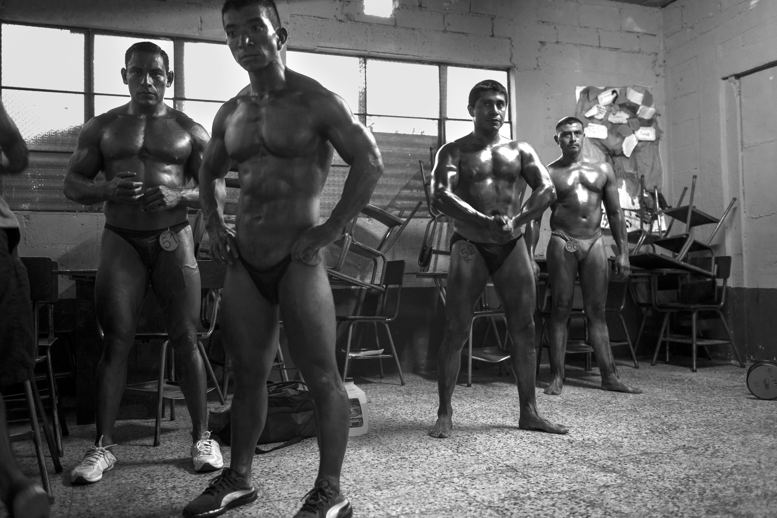A classroom is converted into a prep room at the Gimnasio La Fábrica bodybuilding contest in Antigua, Guatemala.