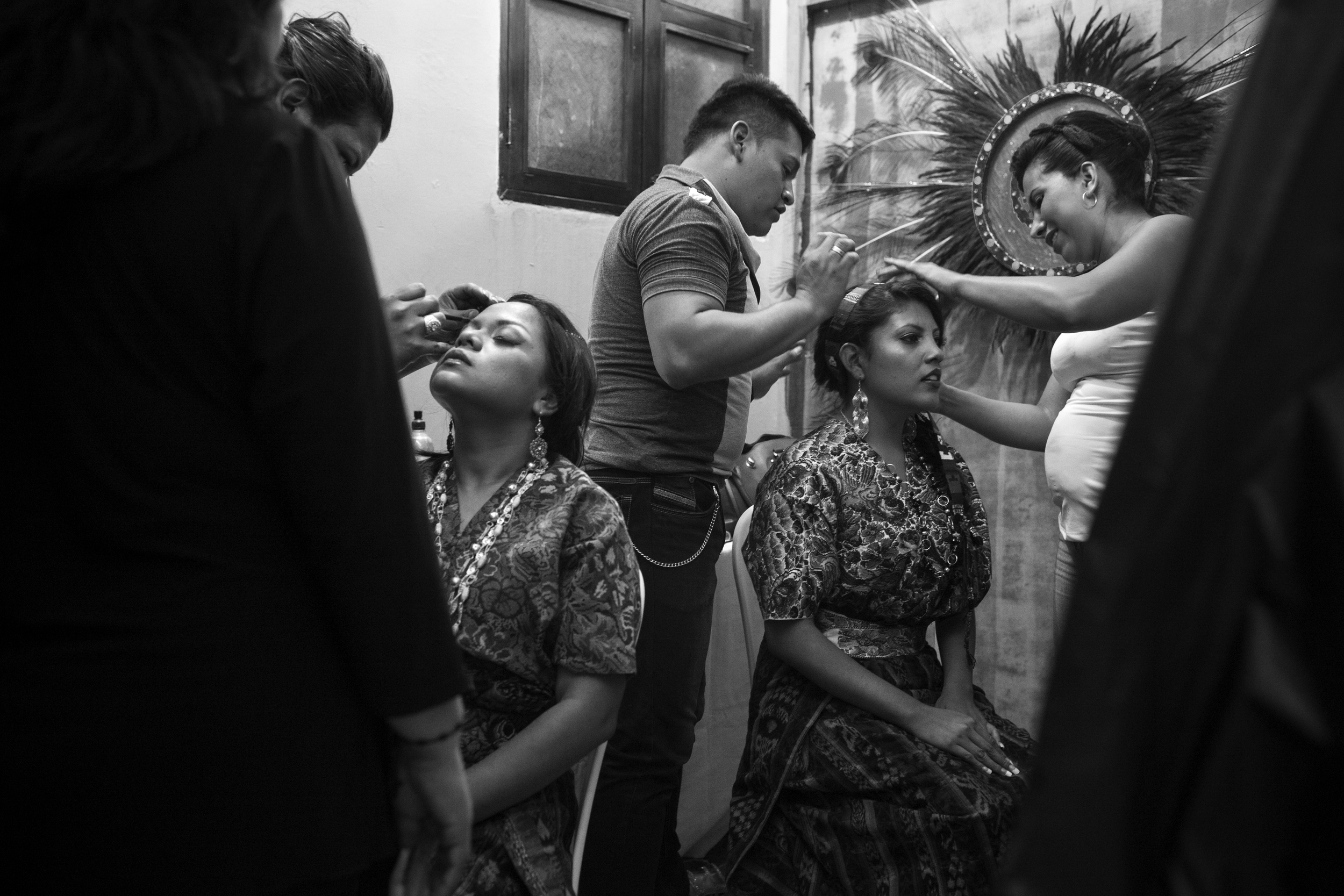Karla López and Lilly Mazariegos have help with make up and outfits at the 2014 Miss Antigua beauty pageant. The winner will compete in the Miss Guatemala beauty pageant. Antigua, Guatemala.