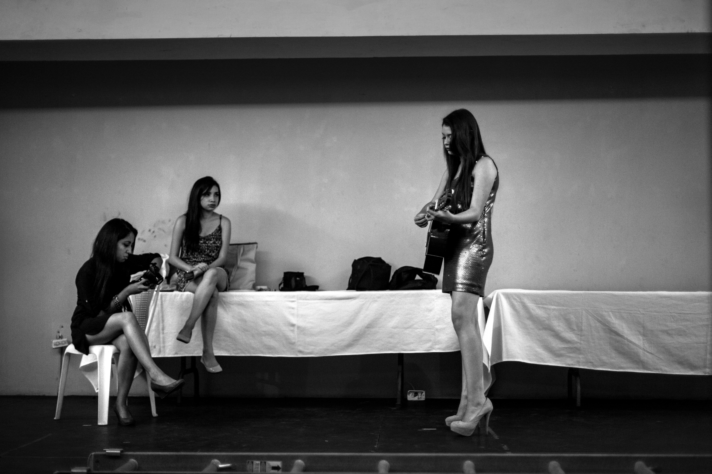 Rehearsing backstage for the 2014 Miss Antigua beauty pageant. Antigua, Guatemala.