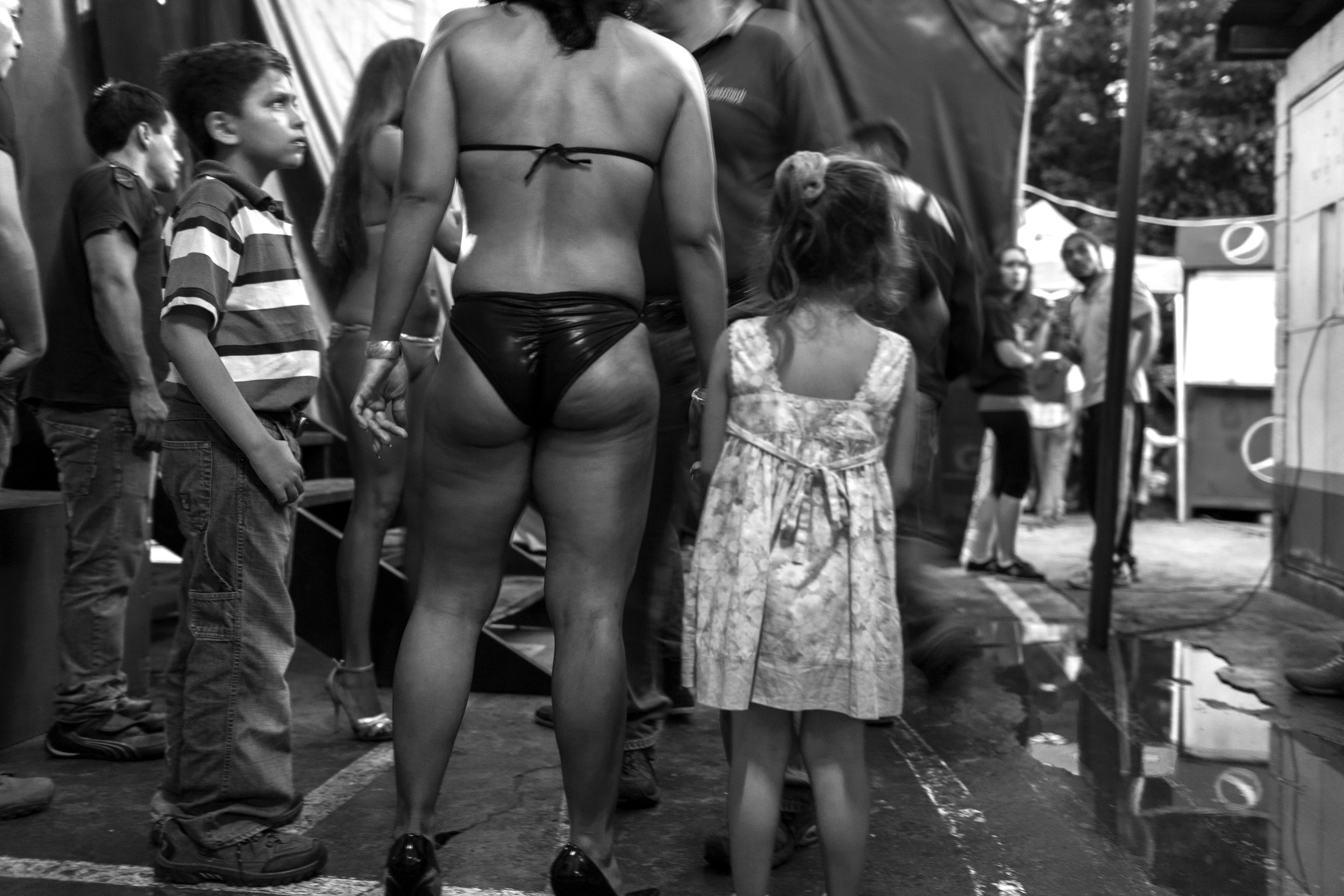 A female bodybuilder and her family backstage at the Gimnasio La Fábrica bodybuilding contest in Antigua, Guatemala.