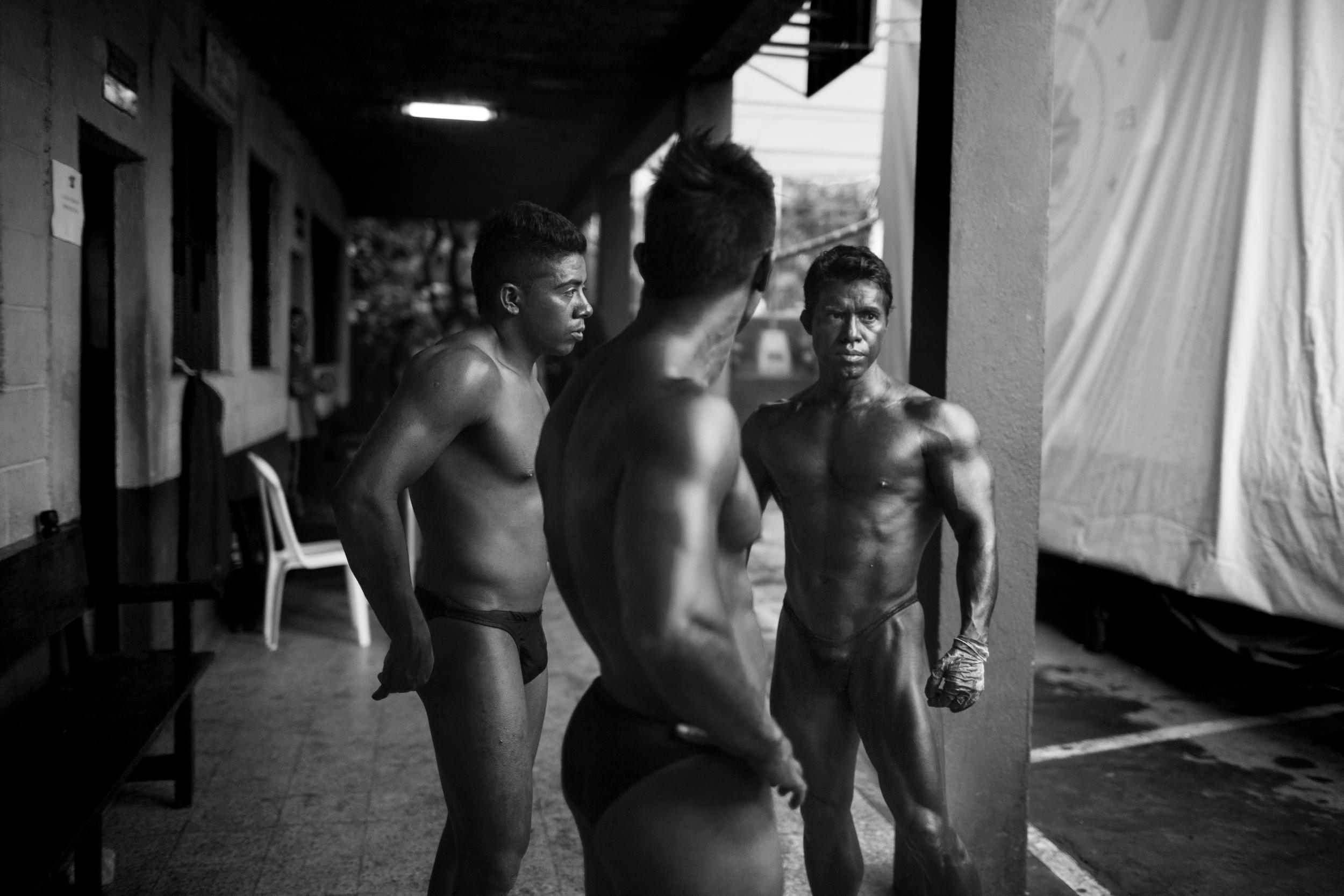 Competitors before the Gimnasio La Fábrica bodybuilding contest in Antigua, Guatemala.