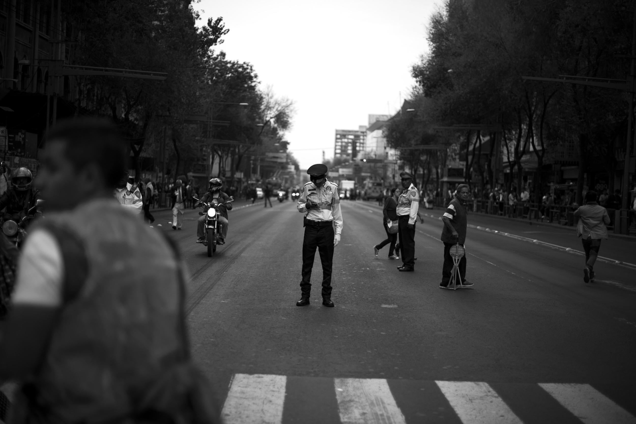 """Police officers block a street near Mexico City's main plaza before a massive demonstration. Protesters demanded President Enrique Peña Nieto's resignation and chanted """" Vivos se los llevaron y vivos los queremos""""  (They were taken alive, we want them alive).Mexico City, Mexico. November 20, 2014."""