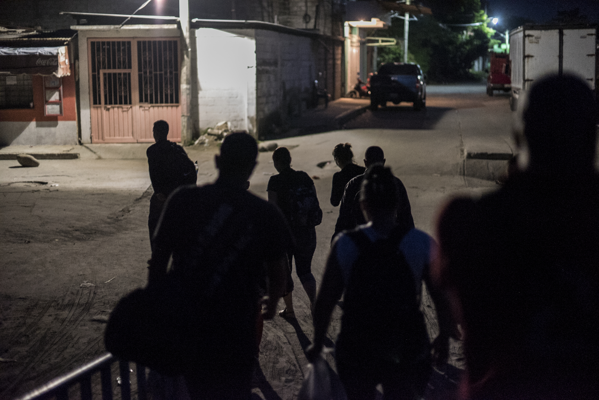 Cuban refugees, who just crossed the Suchiate River into Mexico from Guatemala, head into Ciudad Hidalgo to get a bus to nearby Tapachula in the early morning hours of October 15, 2015.