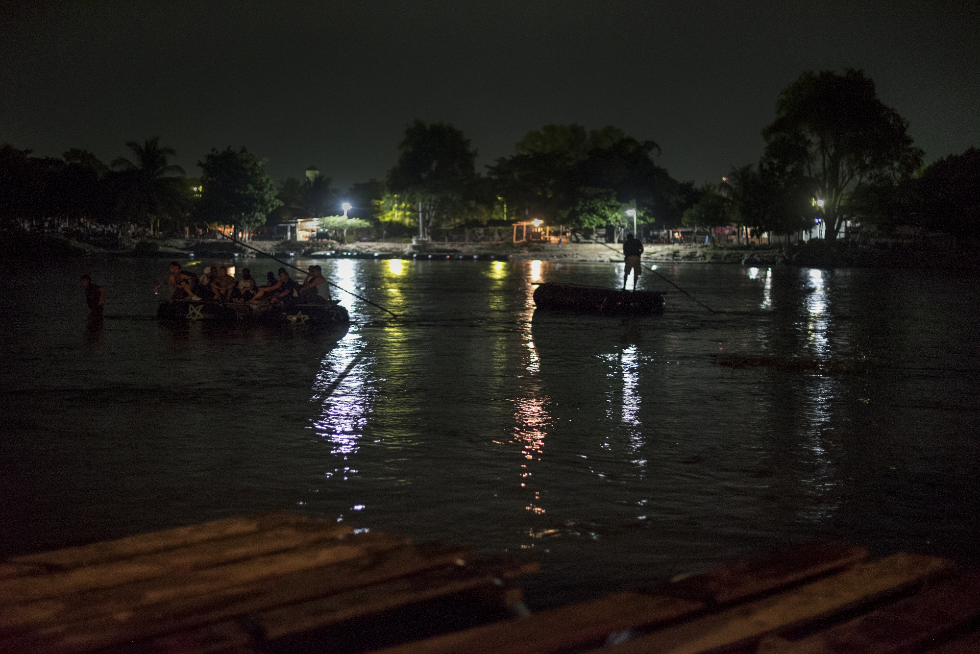 Cuban refugees cross the Suchiate River into Mexico from Guatemala in the early morning hours, their 8th border crossing since leaving Cuba a month earlier.