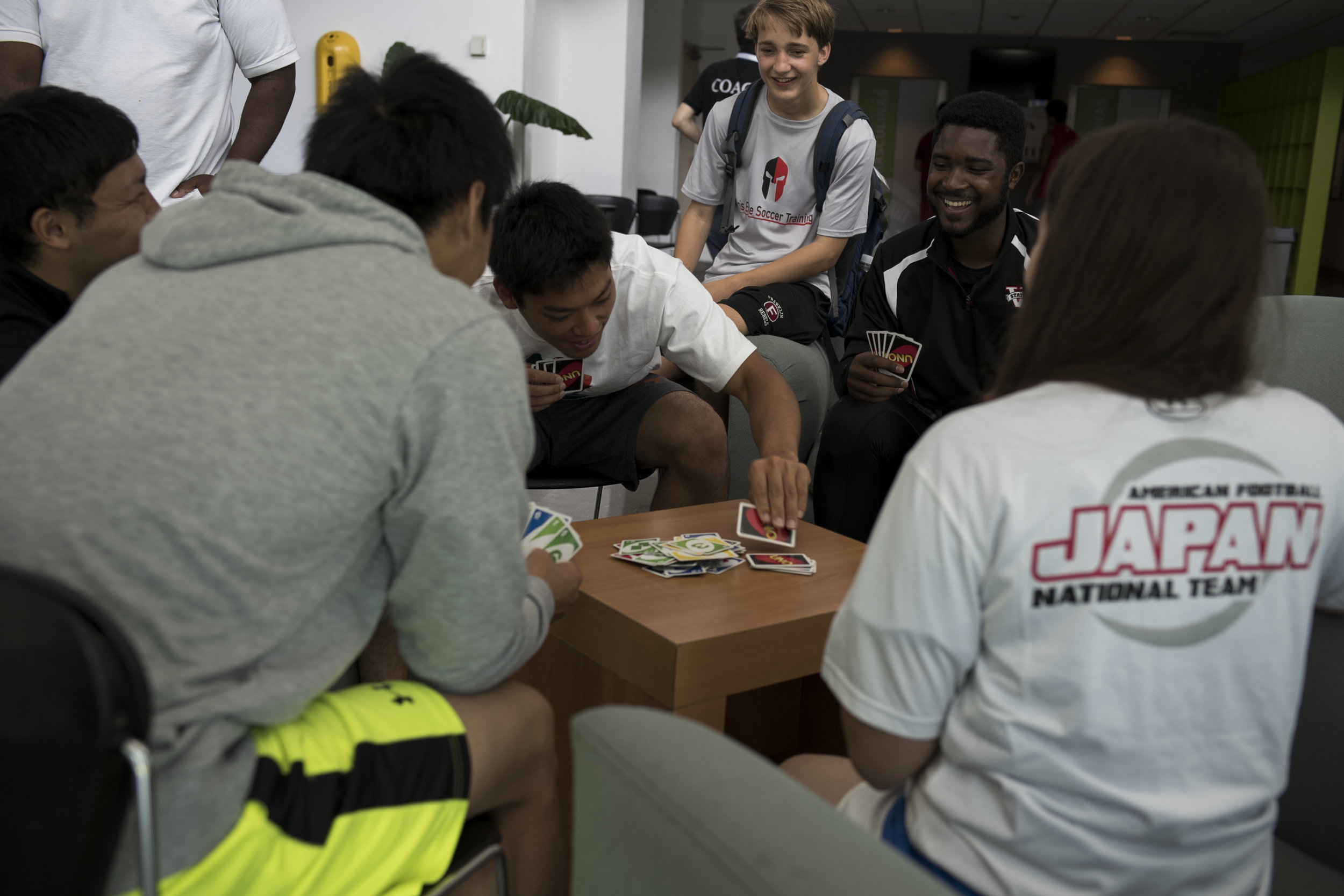 United States quarterback Elgin Hilliard Jr plays Uno with Japanese players in the dorms at the 2016 American Football World University Championship on June 10, 2016 in Monterrey, Mexico. Many of the players talked about the camaraderie and sense of brotherhood on display throughout the tournament and across nationalities.