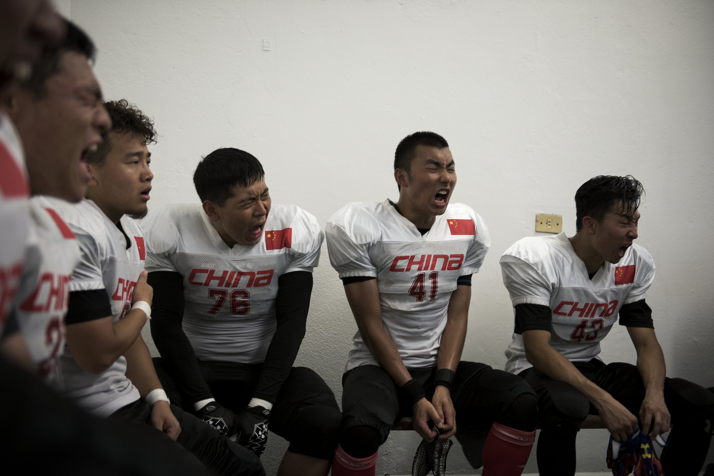 Chinese players react to their coach's motivation during halftime of their final game of the 2016 American Football World University Championship against Japan on June 10, 2016 in Monterrey, Mexico.