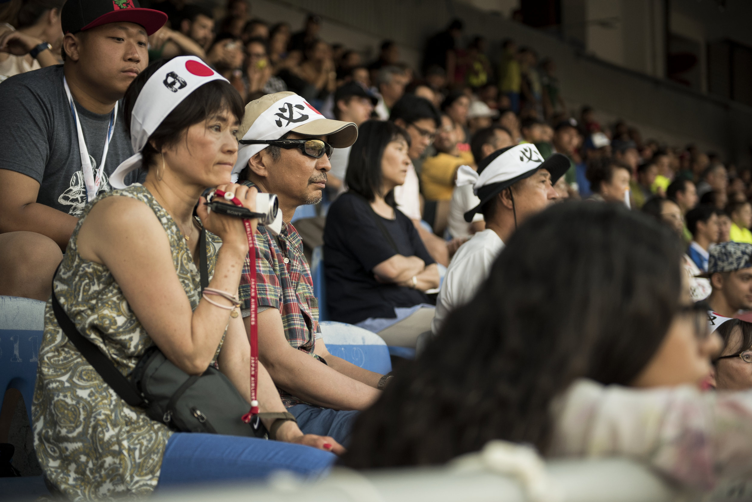 Japanese parents watch anxiously as Japan battles Mexico at the 2016 American Football World University Championship, ultimately losing 36-3 on June 08, 2016 in Monterrey, Mexico.