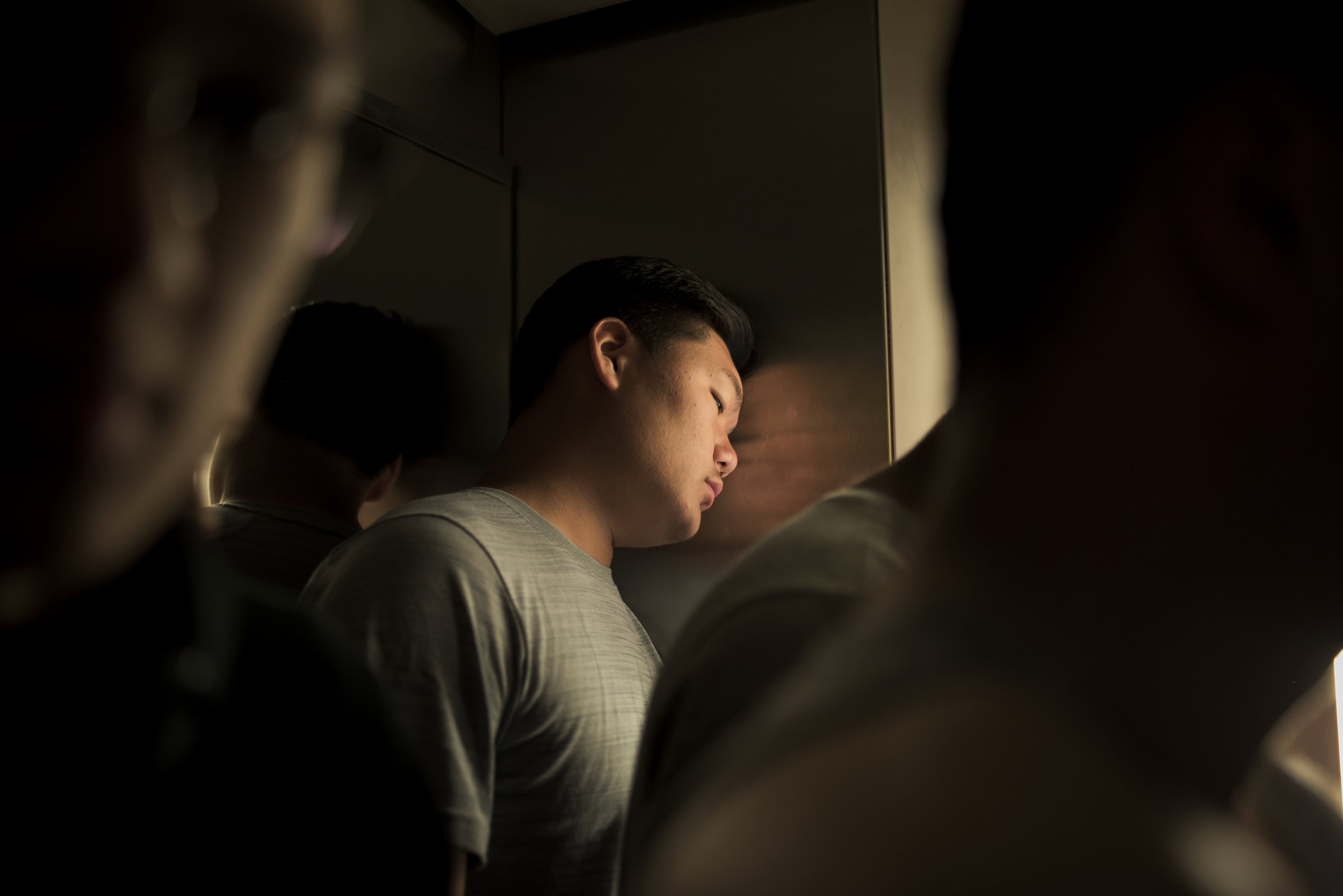 Chinese tight end Liwen Zhang rests his head in an elevator before their game against the Japanese that evening at the 2016 American Football World University Championship on June 10, 2016 in Monterrey, Mexico.