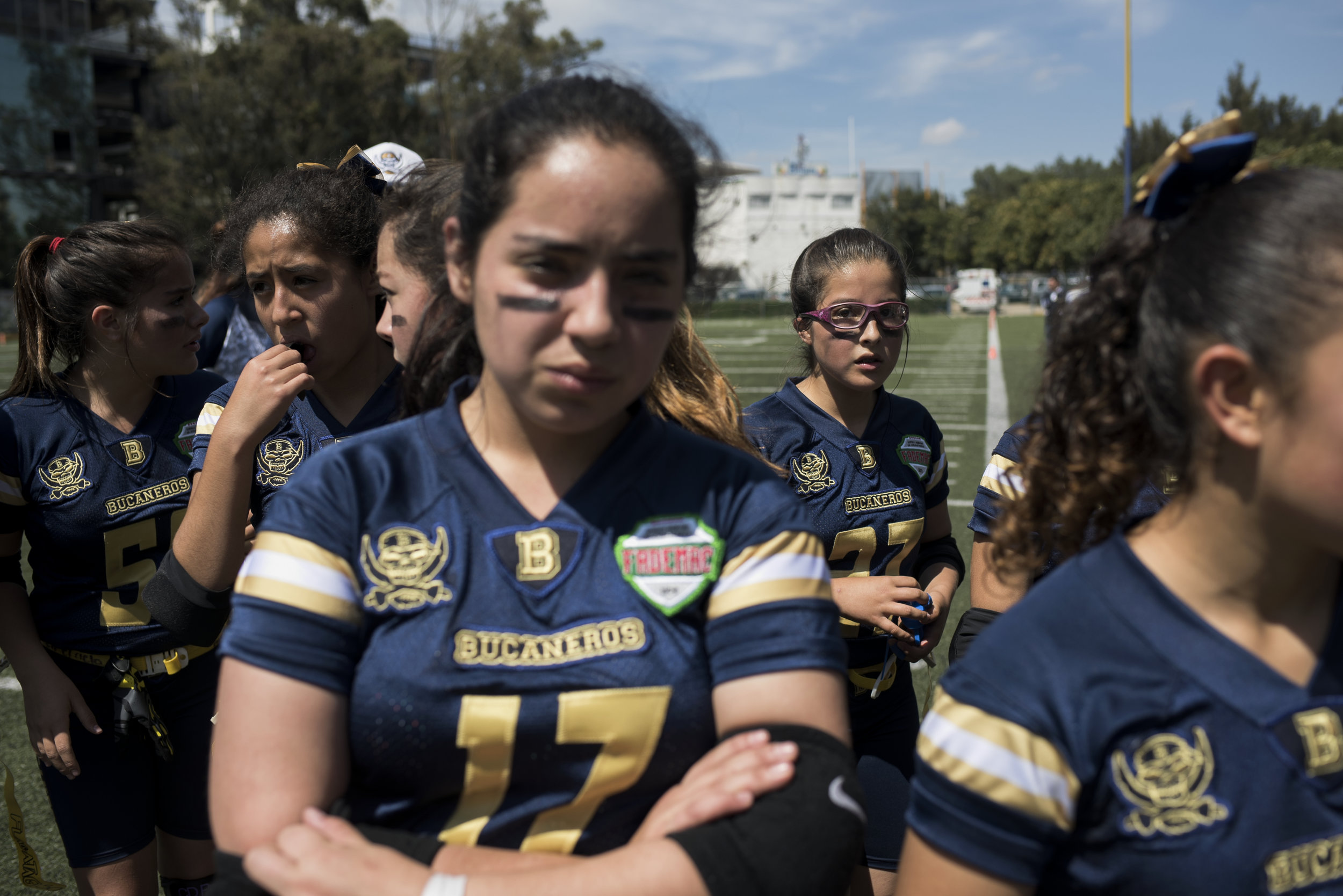 MEXICO CITY, MEXICO - OCTOBER 23: Isabella Villalobos, center, was to the locker room during halftime of their flag football game on October 23, 2016 in Mexico City. This is Isabella's second game playing flag football.