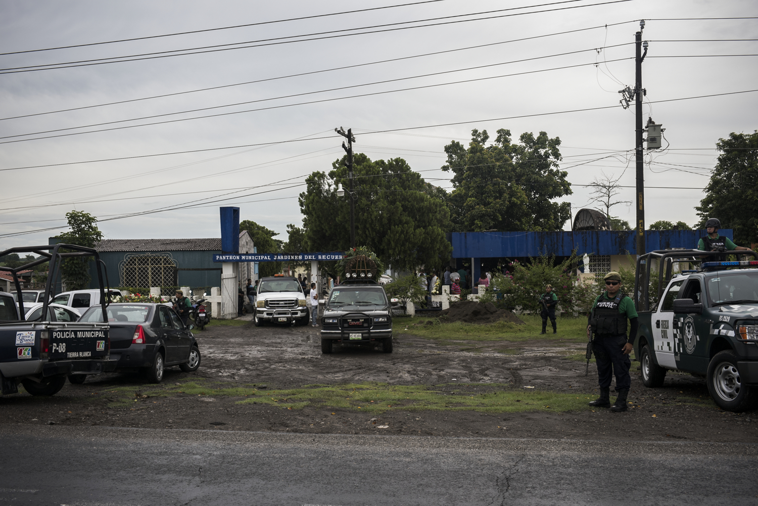 "State police provide security for Pedro Tamayo's funeral in Tierra Blanca, Veracruz on July 22, 2016.   Tamayo was a journalist in Tierra Blanca and was supposed to be under state protection at the time of his murder. But turf battle between Los Zetas and the Nuevo Generación cartels has caused violence in  Veracruz to skyrocket and both organizations have thoroughly infiltrated state and municipal security.   ""It is difficult to tell where organized crime ends and the state begins,"" said one activist."