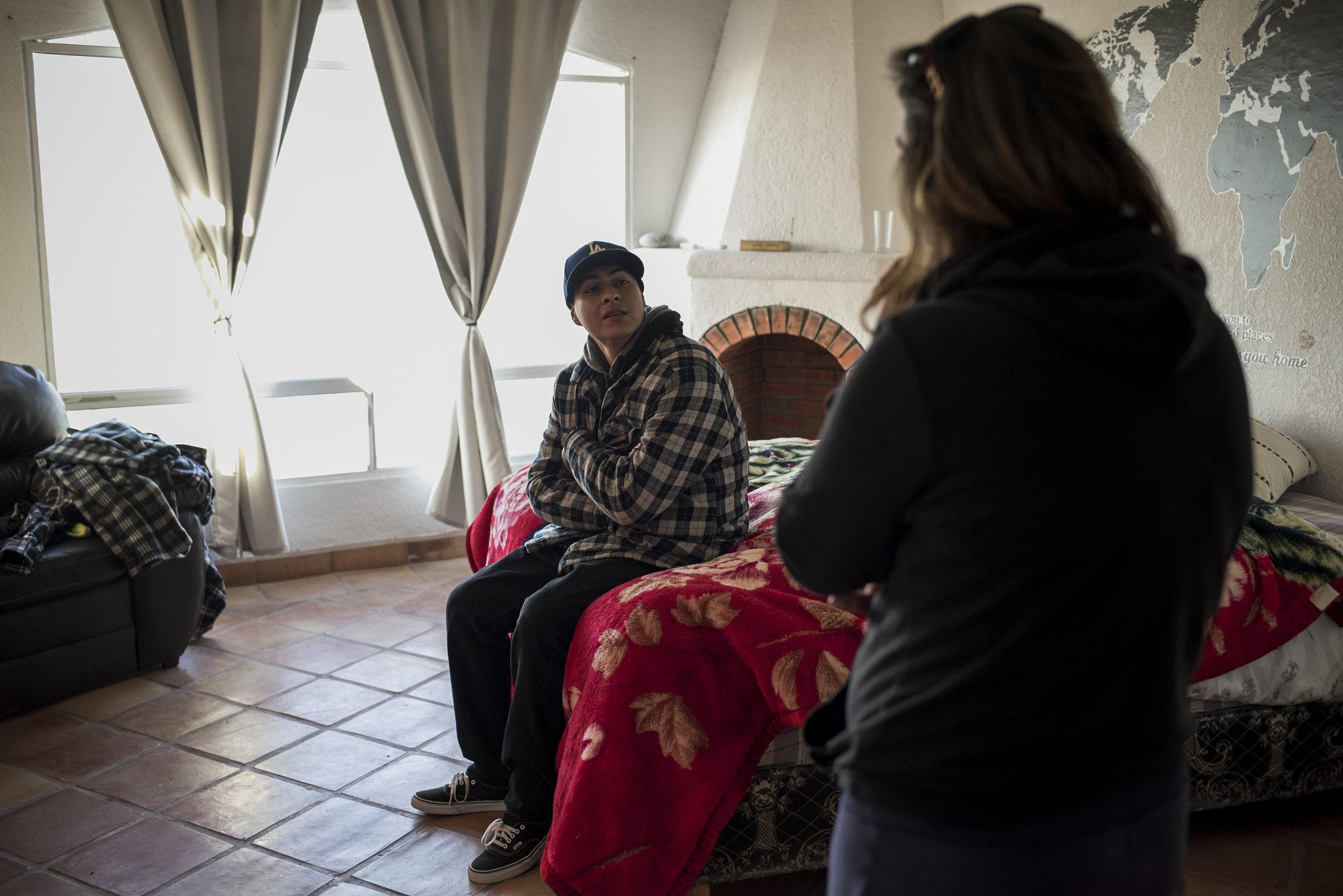 ROSARITO, MEXICO- Feb 13, 2018: A staff member at The Ibogaine Institute talks to Andrew Ortega, a heroin addict who was just treated with a pyschedelic drug called Ibogaine on February 12, 2018 in Rosarito, Mexico. Ibogaine is a psychedelic drug that is illegal in the United States but has been shown to dramatically reduce opioid withdrawals and reduce long term addiction.(Jonathan Levinson for The World)