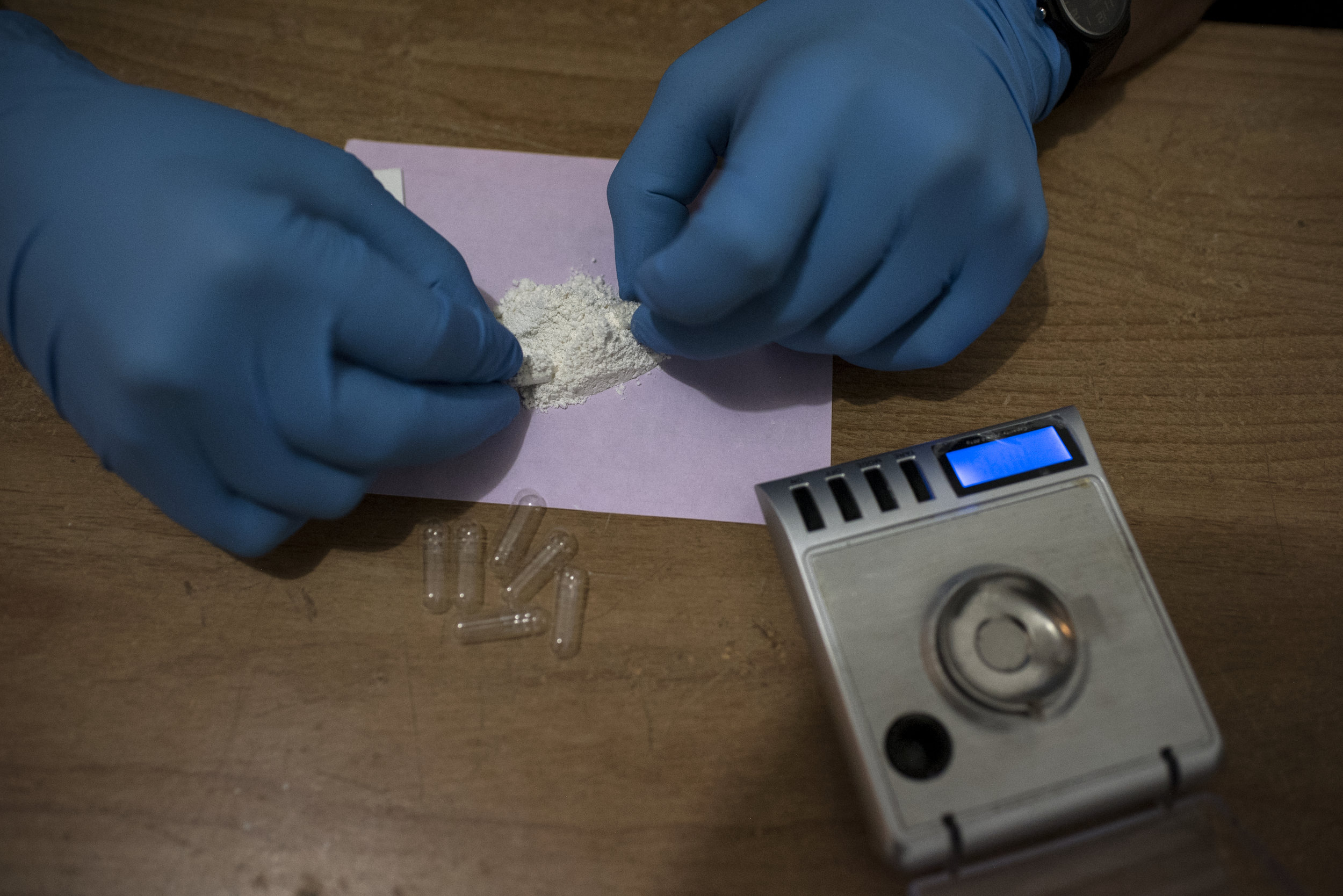 Doctor Fernando Gomez, the Institute's physician,makes Ibogaine pills based on the patient's body weight.