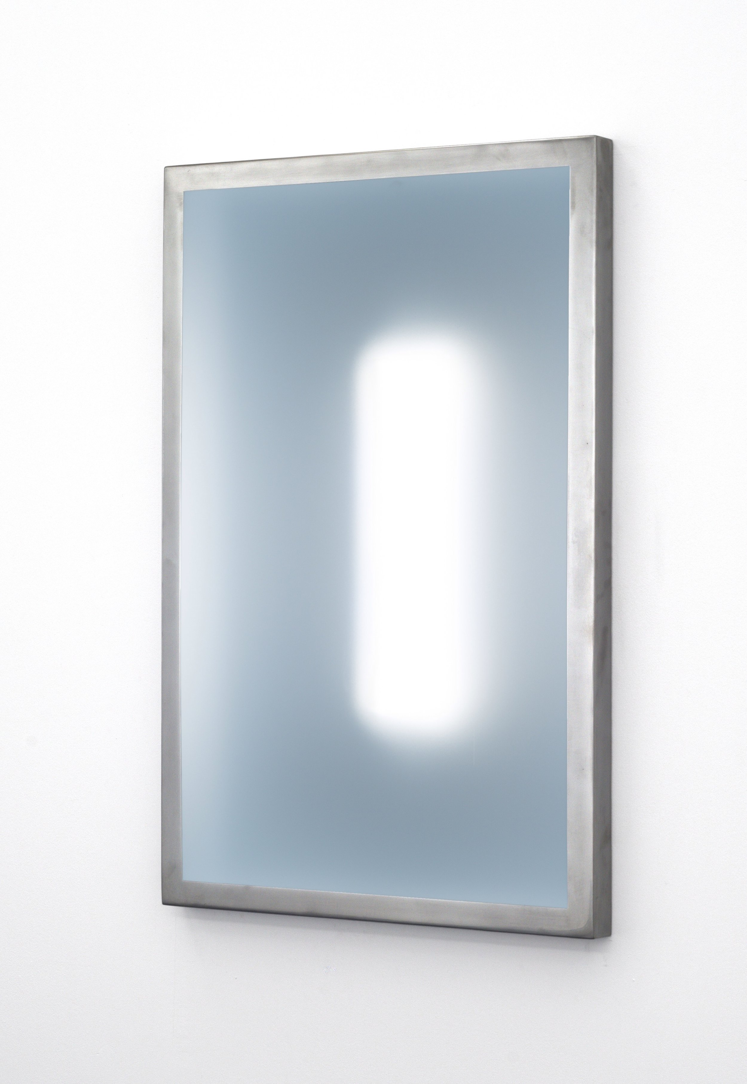 """(24""""H x 18""""L x 1.5""""W, view from right side)     This three dimensional wall piece, constructed out of steel, acrylic, and LEDs captures the viewer's attention by creating a calm, meditative, and introspective atmosphere. The clarity of the illuminated elusive interior shape shifts depending on the viewer's physical relationship to the piece."""