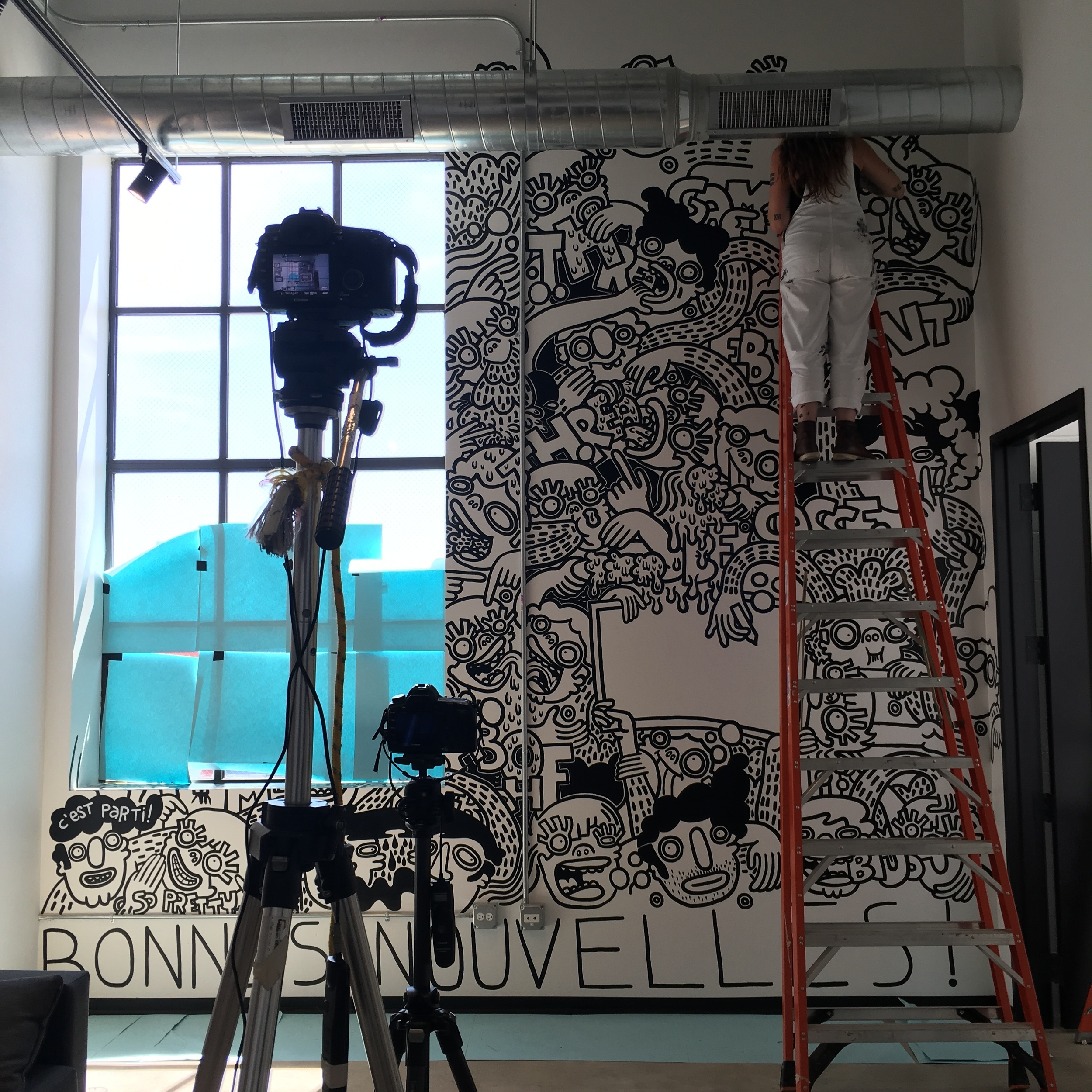 SO CLOSE TO BEING DONE. THOSE TIMELAPSE CAMERAS TOOK THOUSANDS OF PICTURES DURING THE CREATION OF THIS MURAL.
