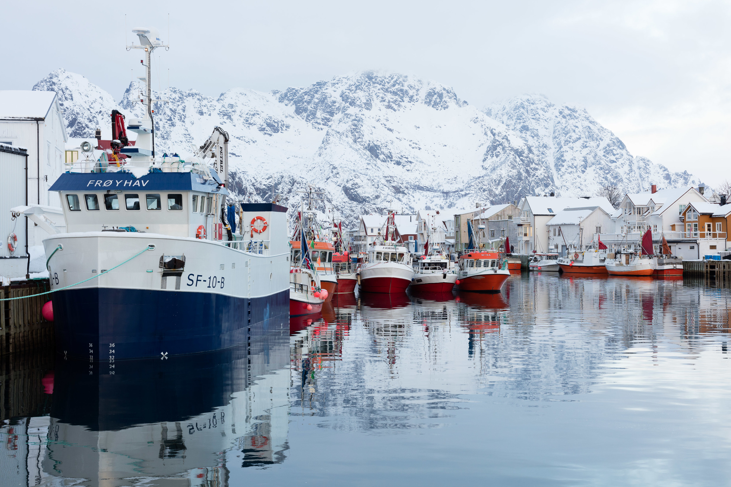 Henningsvær, Lofoten. Local fishing boats in the afternoon, ready for getting out early the next day.