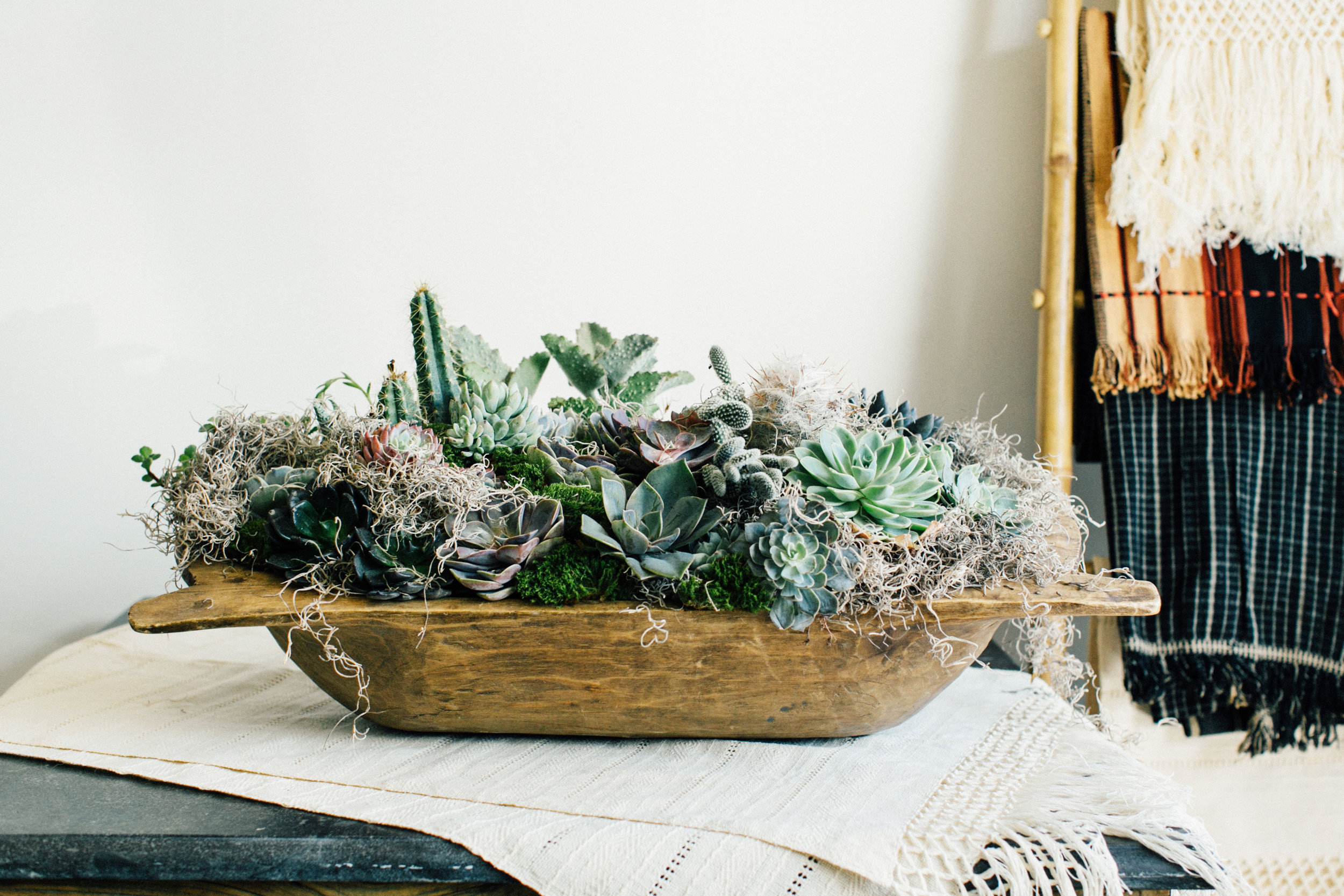 Here are some faux pieces mixed with real, and we love seeing them in one of Pottery Barn's dough bowls from years past.  Arrangement | Colonial House of Flowers