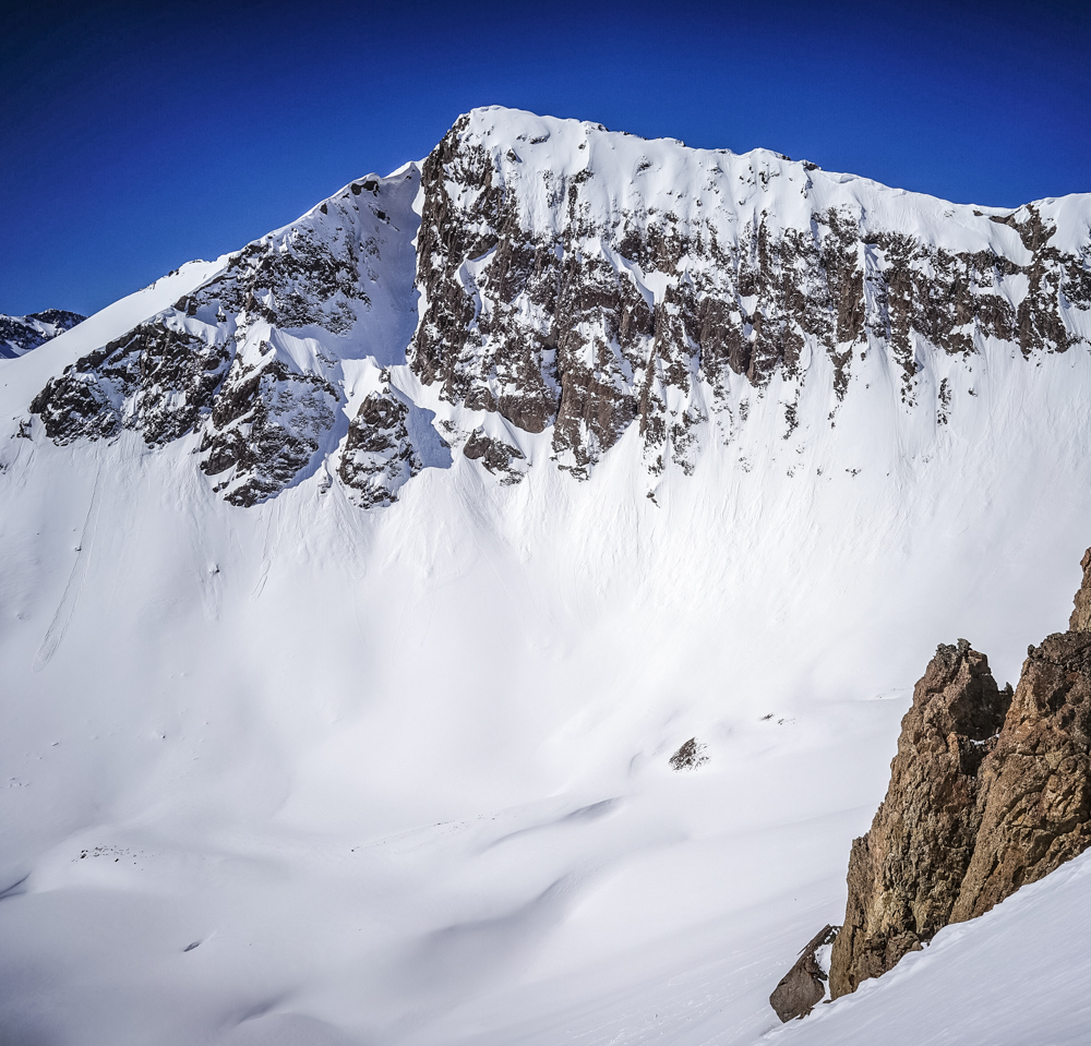 I took this photo on my phone a year ago of a line some folks call 'Peruvian.' This peak is an unnamed point near Indy Pass. Though not that big or long, I've really wanted to ski it all season. Today Vince and I climbed up in a snowstorm and skied down in the sun.