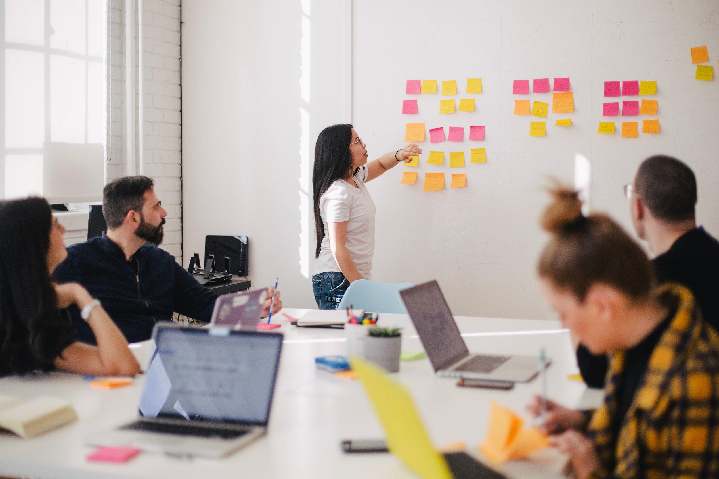 Diverse nonprofit staff developing strategies