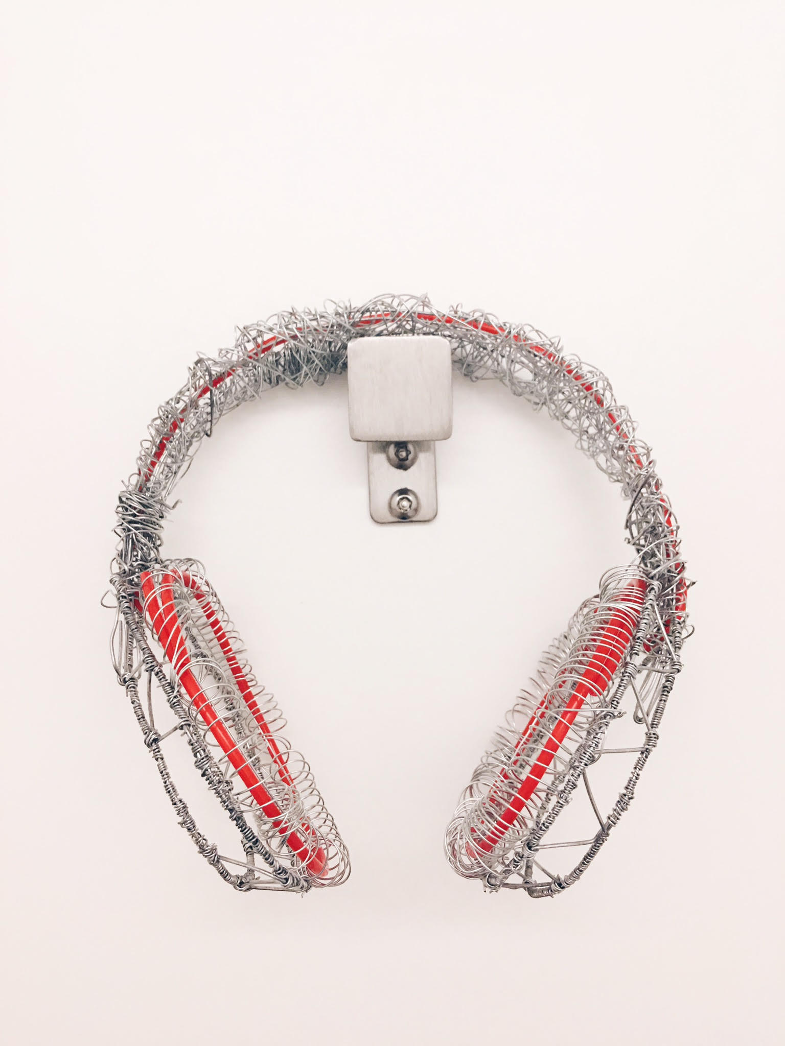 A pair of wire headphones. My first major project at Parsons for my Space and Materiality class, we had to sculpt the object we always carried with us.