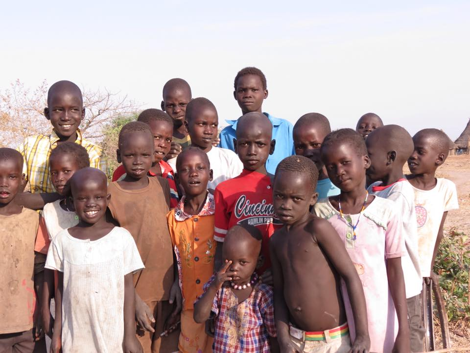 Village boys near cattle camp in machar