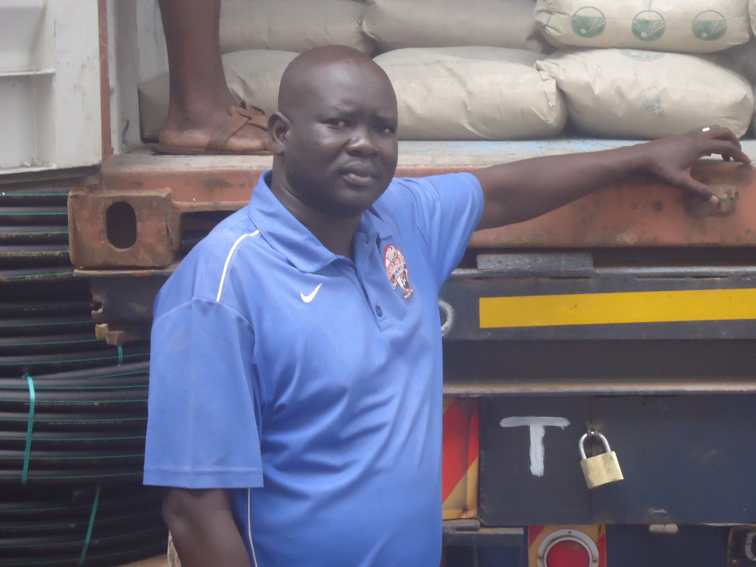 "WFSS Field Operations Manager Ajang ""AJ"" Agok with supply truck in Kampala."
