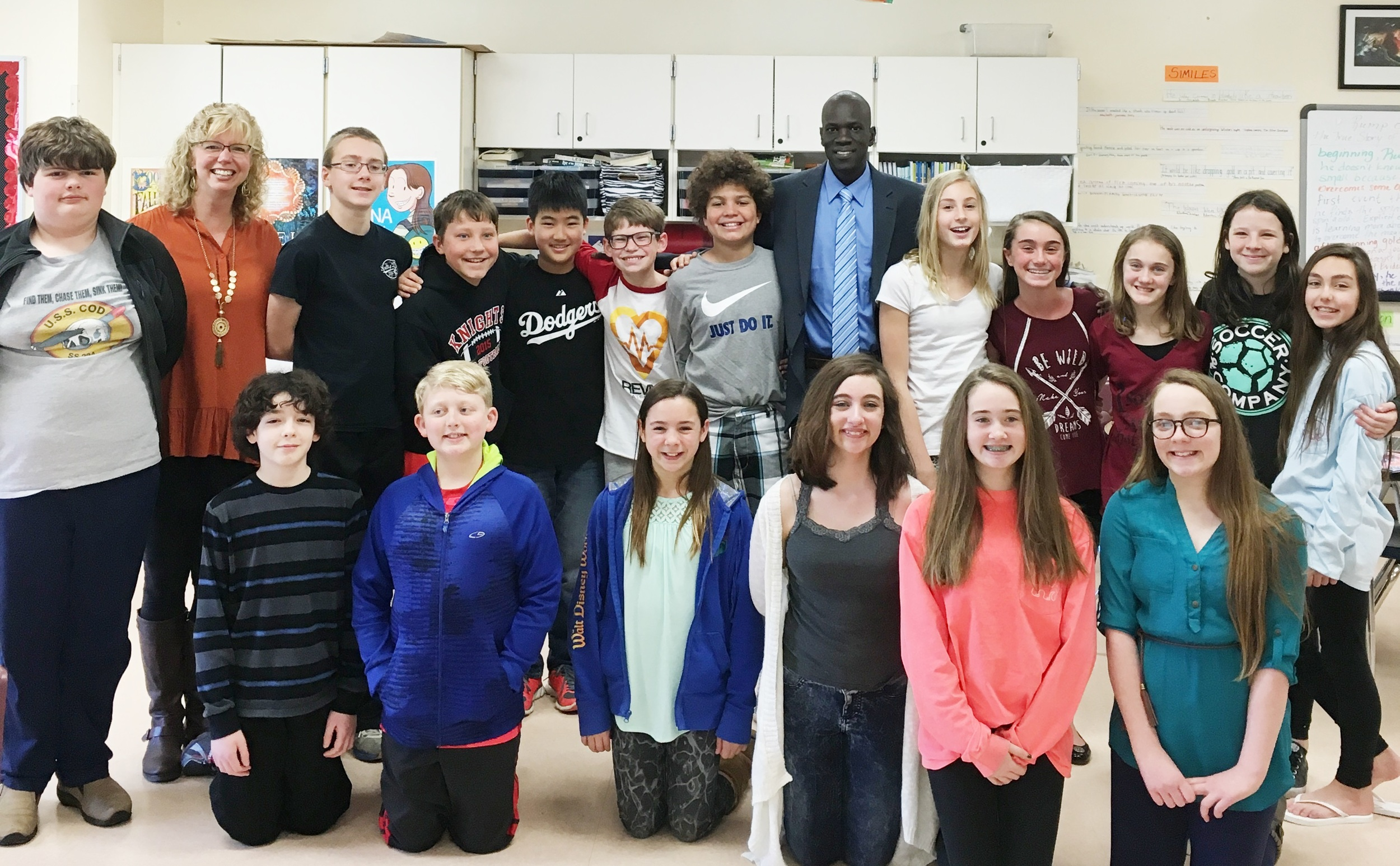 Salva dut with columbia intermediate school students and teacher holly mueller