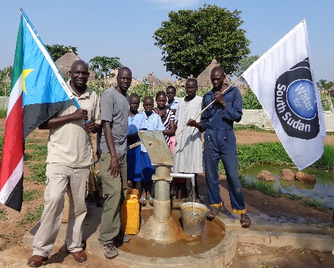 WFSS Country Director Ater Thiep, left, and Founder Salva Dut at WFSS well in Wau.