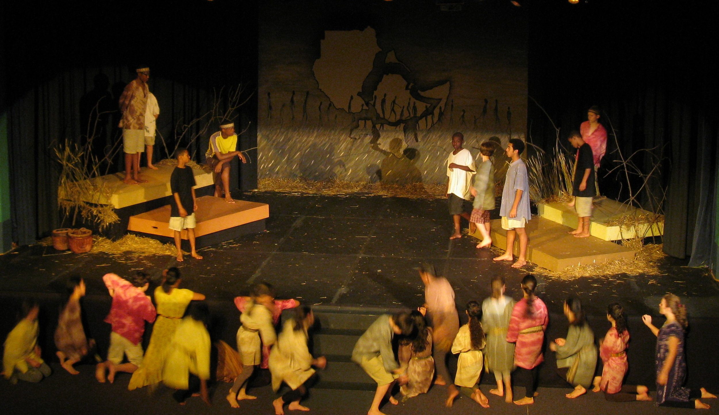 The action shifts between the ensemble (as in a classical Greek chorus) and the Walking Boys.