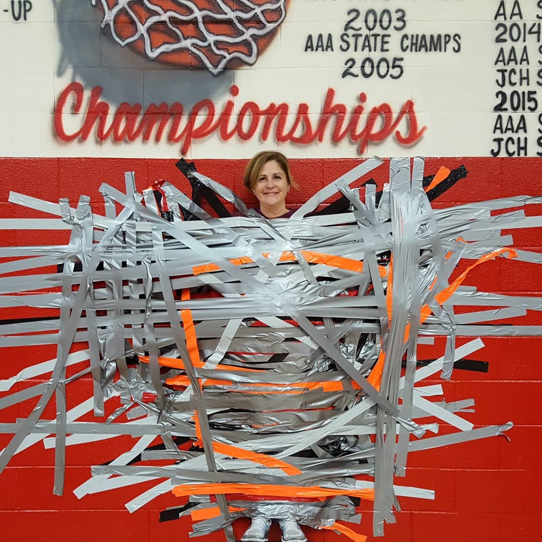 Mrs. Mackzum was duct-taped to the wall as the result of a fundraising incentive for students.