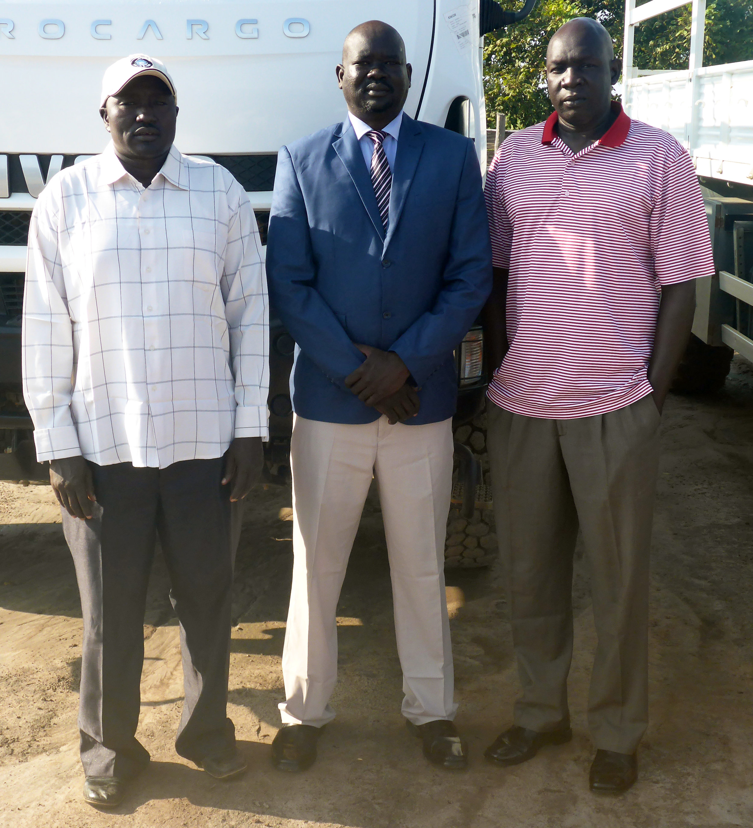 From left to right: Abraham (author), and Associate Country Directors  AJ  and  A ter