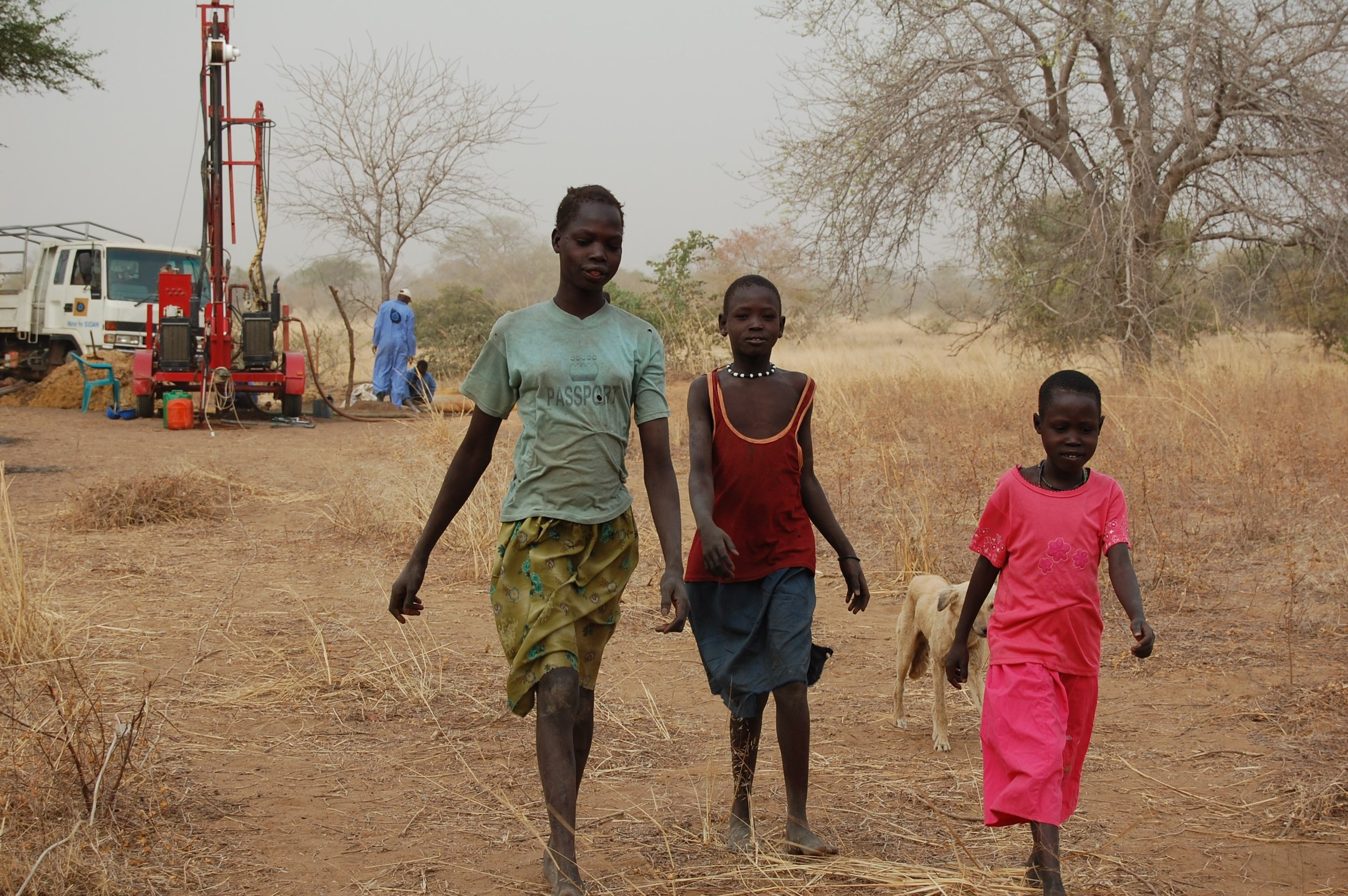 Village girls in Abilnyang during a deep-water well installation in March 2008