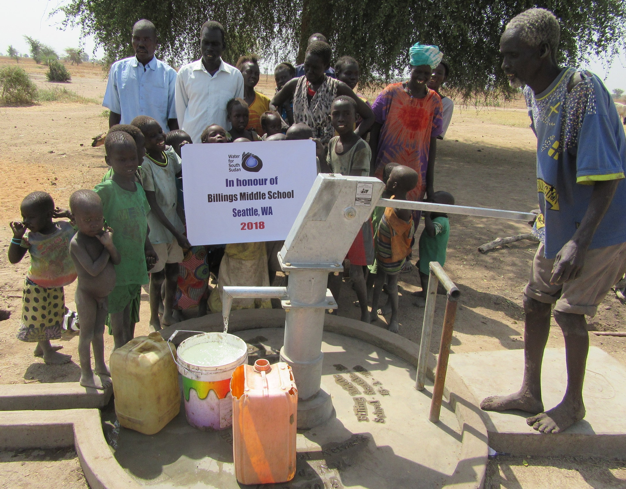 Villagers in Wut-Nyap Village in Aweil East celebrate their new well.
