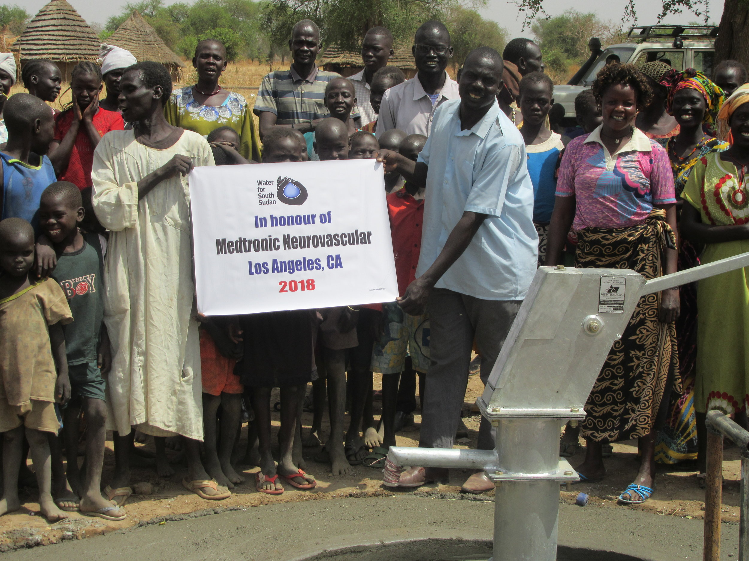 Villagers in Parot Aker village in South Sudan where Medtronic Neurovascular's first well was drilled this year.