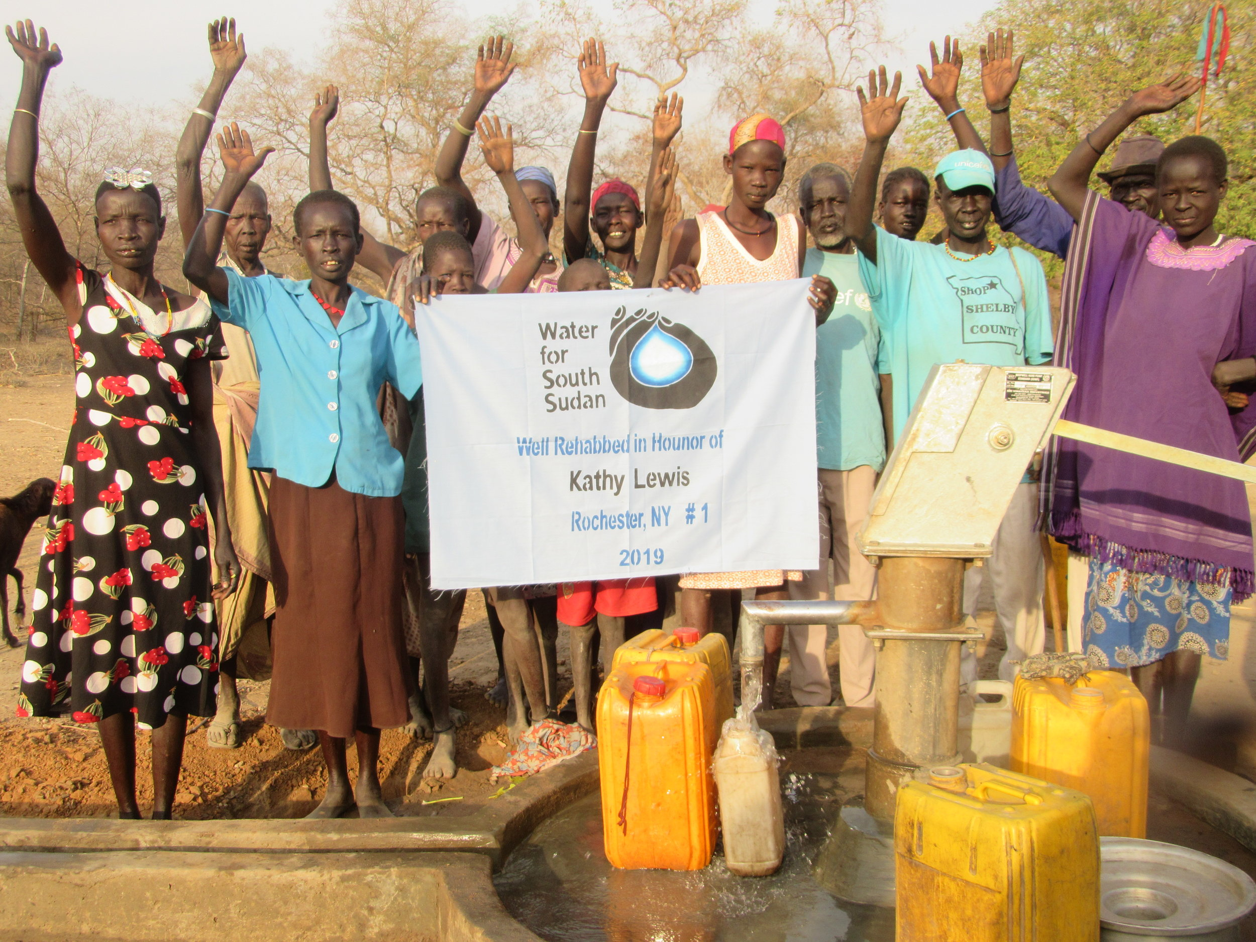 Villagers celebrate the rehabilitation of their well in Tonj State.