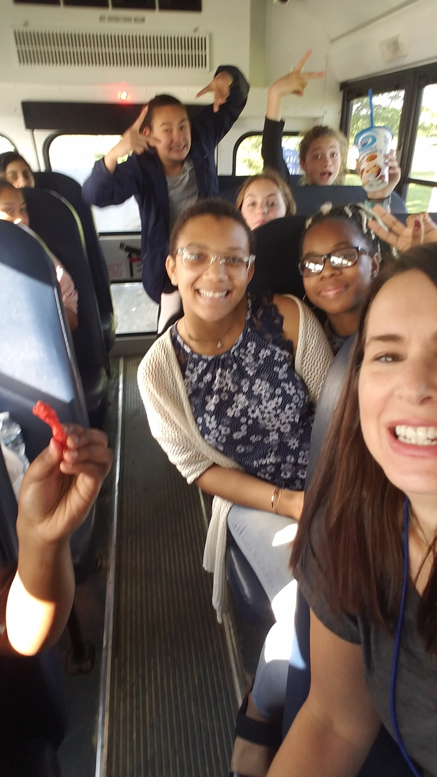 Michelle and Students on Bus.jpg
