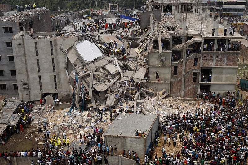A shot of the collapse hours after it happened, with individuals beginning to search for loved ones and co-workers.