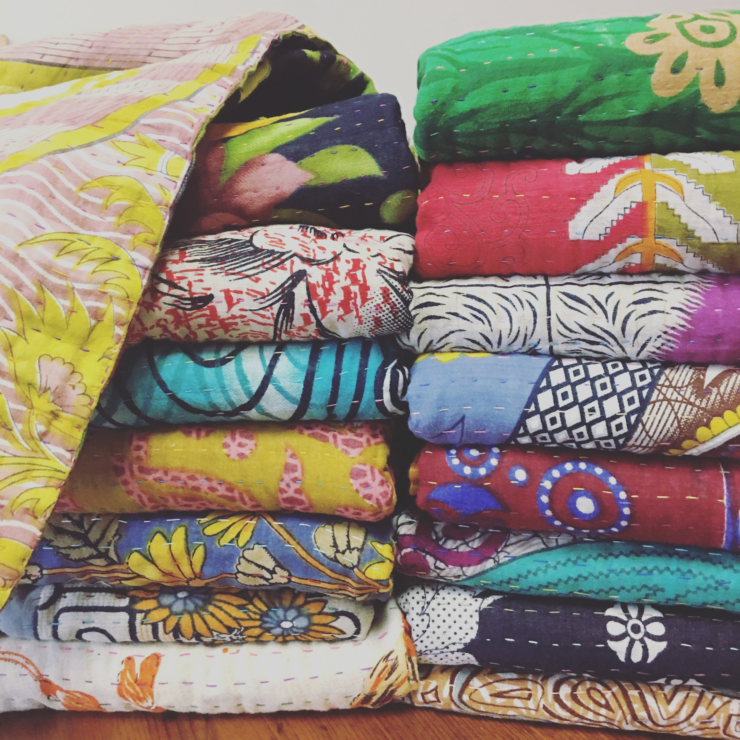 Basha Boutique Throw Blankets, handmade by women in Bangladesh from recycled and vintage saris.