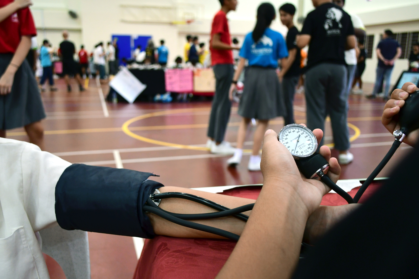 Taking blood pressure with a stethoscope and sphygmomanometer