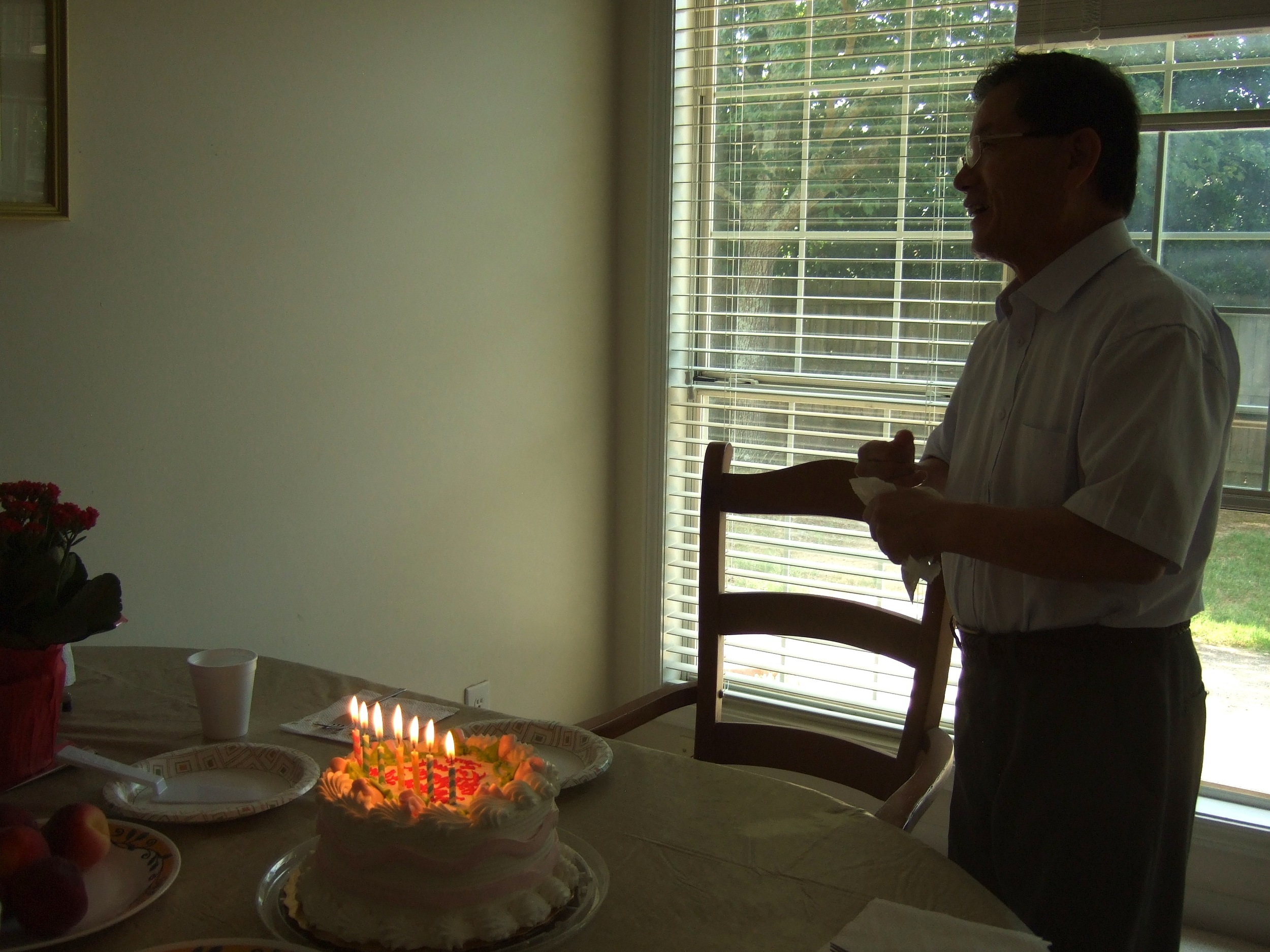 dad_with_lit_cake.jpg
