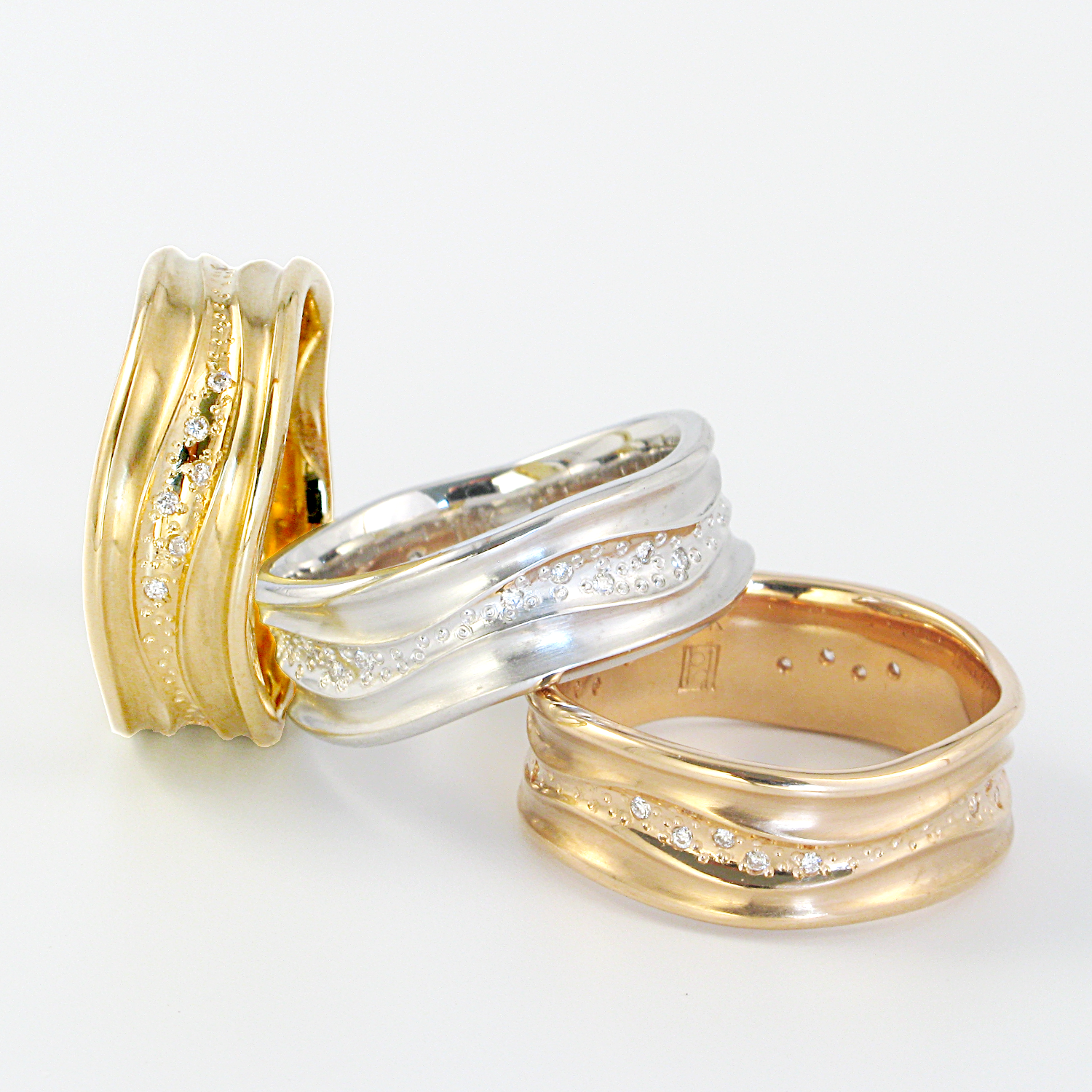 Contemporary wedding bands in 18k yellow, rose or white gold 'Stardust' with diamonds by Pratima Design Fine Art Jewelry