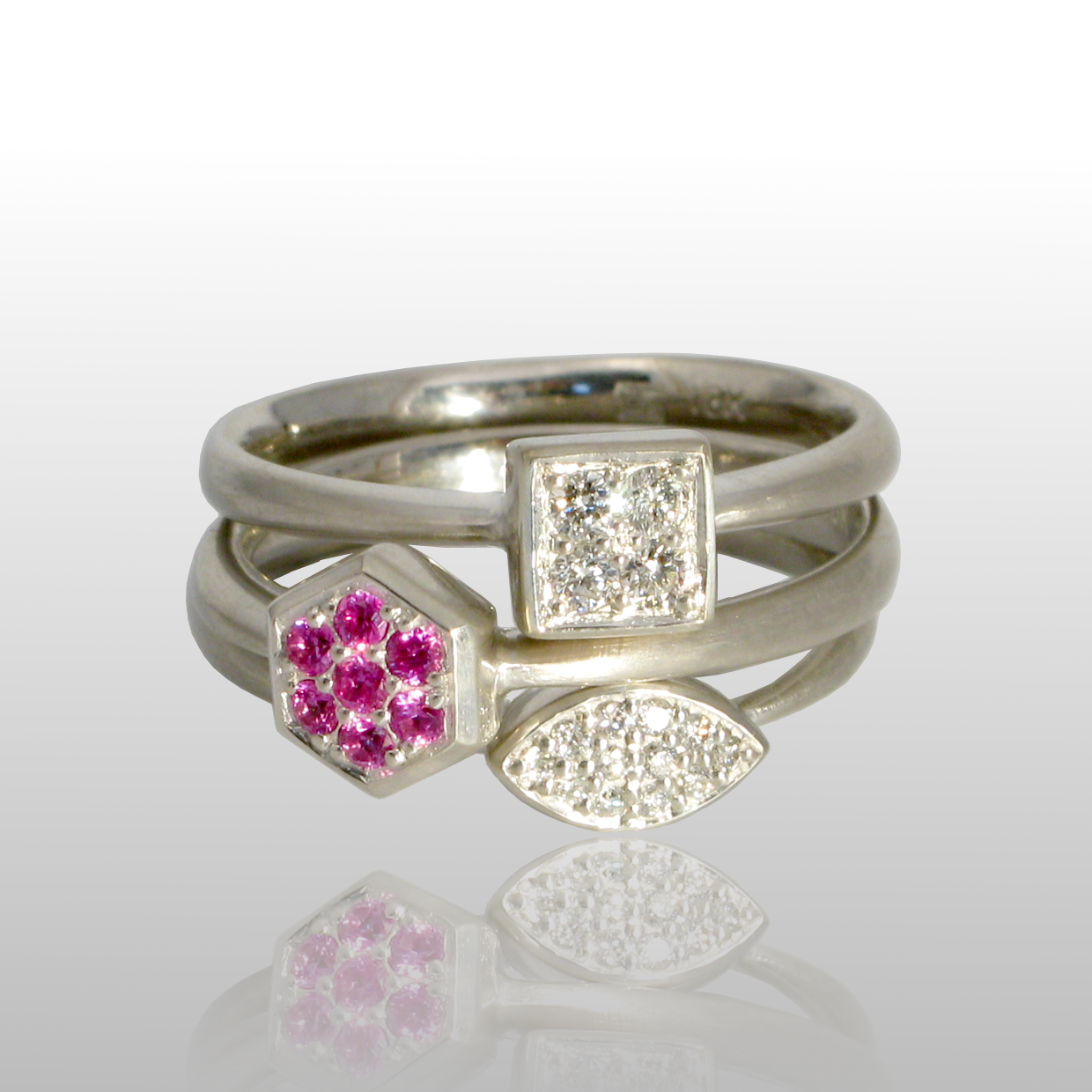 Stackable designer rings 'Stax' in platinum or 18k white gold with diamond and pink sapphire pavé by Pratima Design Fine Art Jewelry