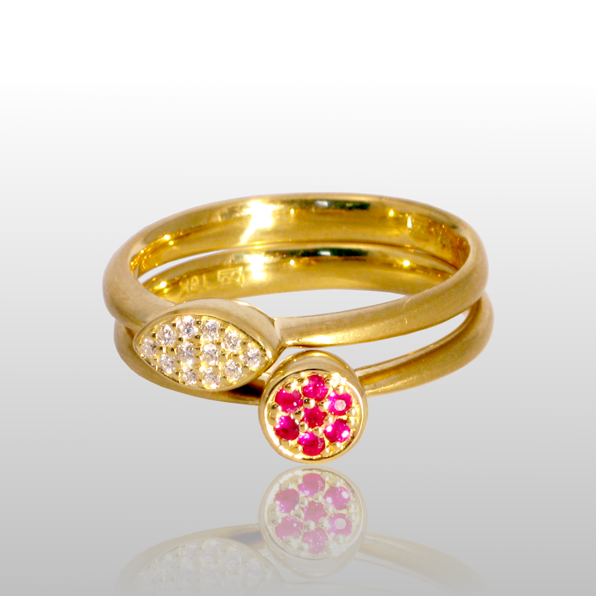 Stackable designer rings 'Stax' in 18k gold with diamond and ruby pavé by Pratima Design Fine Art Jewelry