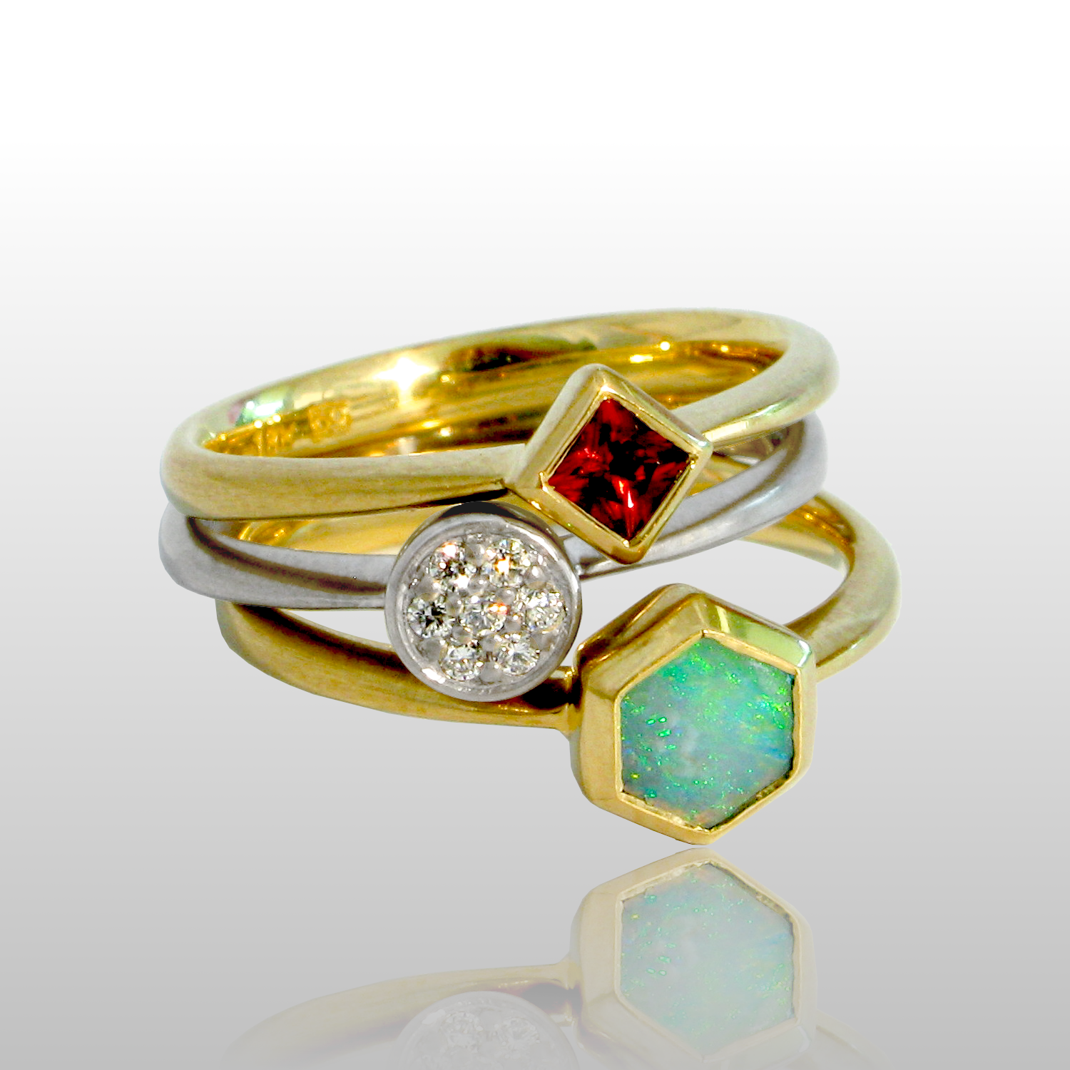 Stackable designer rings in 18k gold 'Stax' with diamond pavé, opal and malayan garnet by Pratima Design Fine Art Jewelry