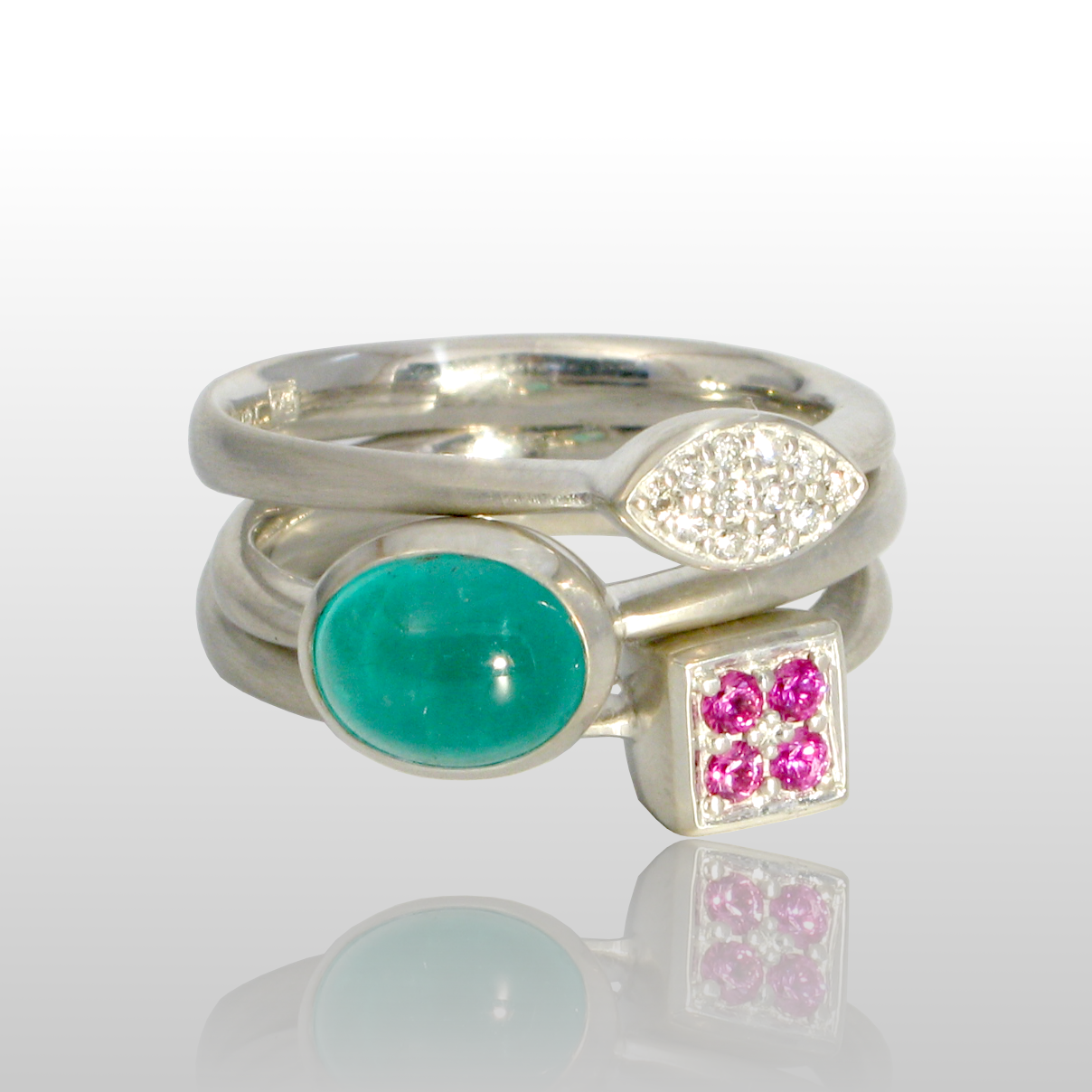 Stackable designer rings in 18k white gold 'Stax' with diamond pavé, emerald and pink sapphire pavé by Pratima Design Fine Art Jewelry