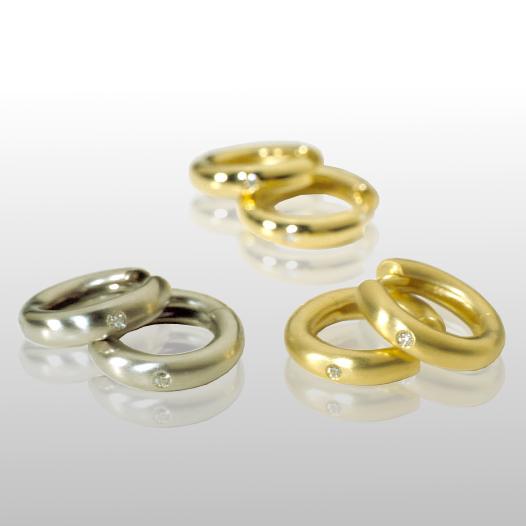 18k gold hinged hoops with diamonds by Pratima Design Fine Art Jewelry